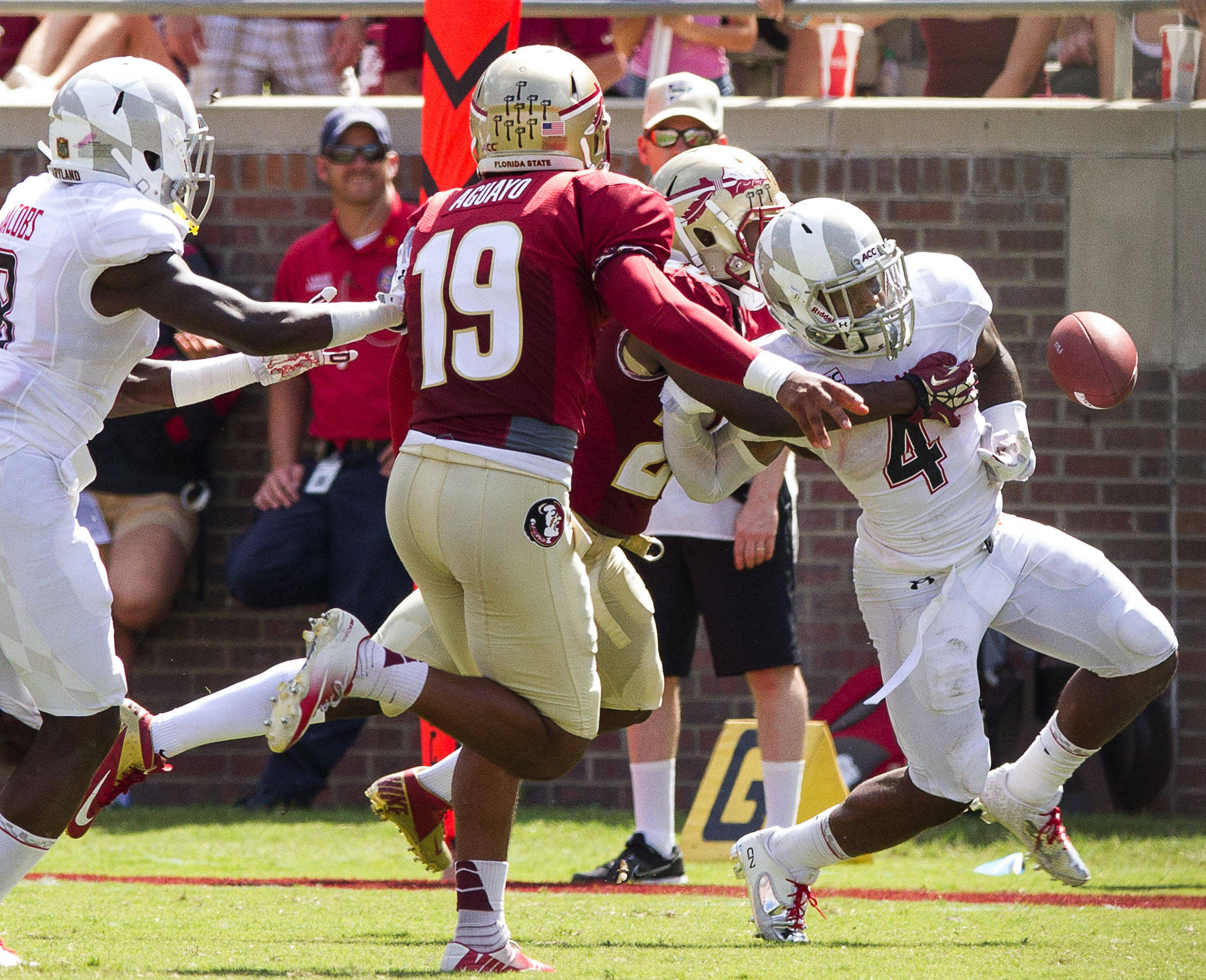 Lamarcus Joyner (20) strips the ball during FSU Football's 63-0 shutout of Maryland on Saturday, October 5, 2013 in Tallahassee, Fla.