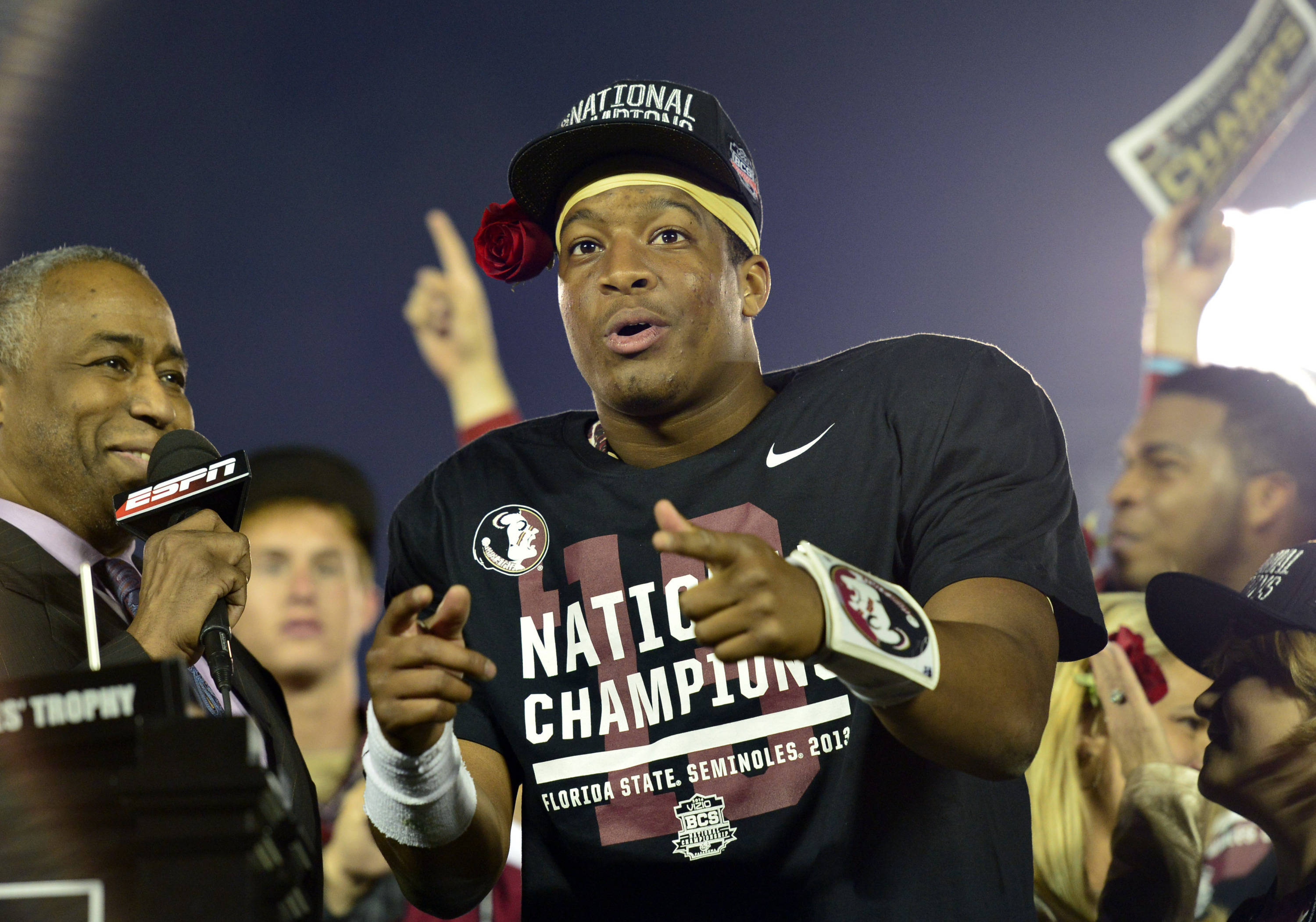 Jan 6, 2014; Pasadena, CA, USA; Florida State Seminoles quarterback Jameis Winston (5) celebrates after winning the 2014 BCS National Championship game against Auburn Tigers 34-31 at the Rose Bowl.  Mandatory Credit: Richard Mackson-USA TODAY Sports