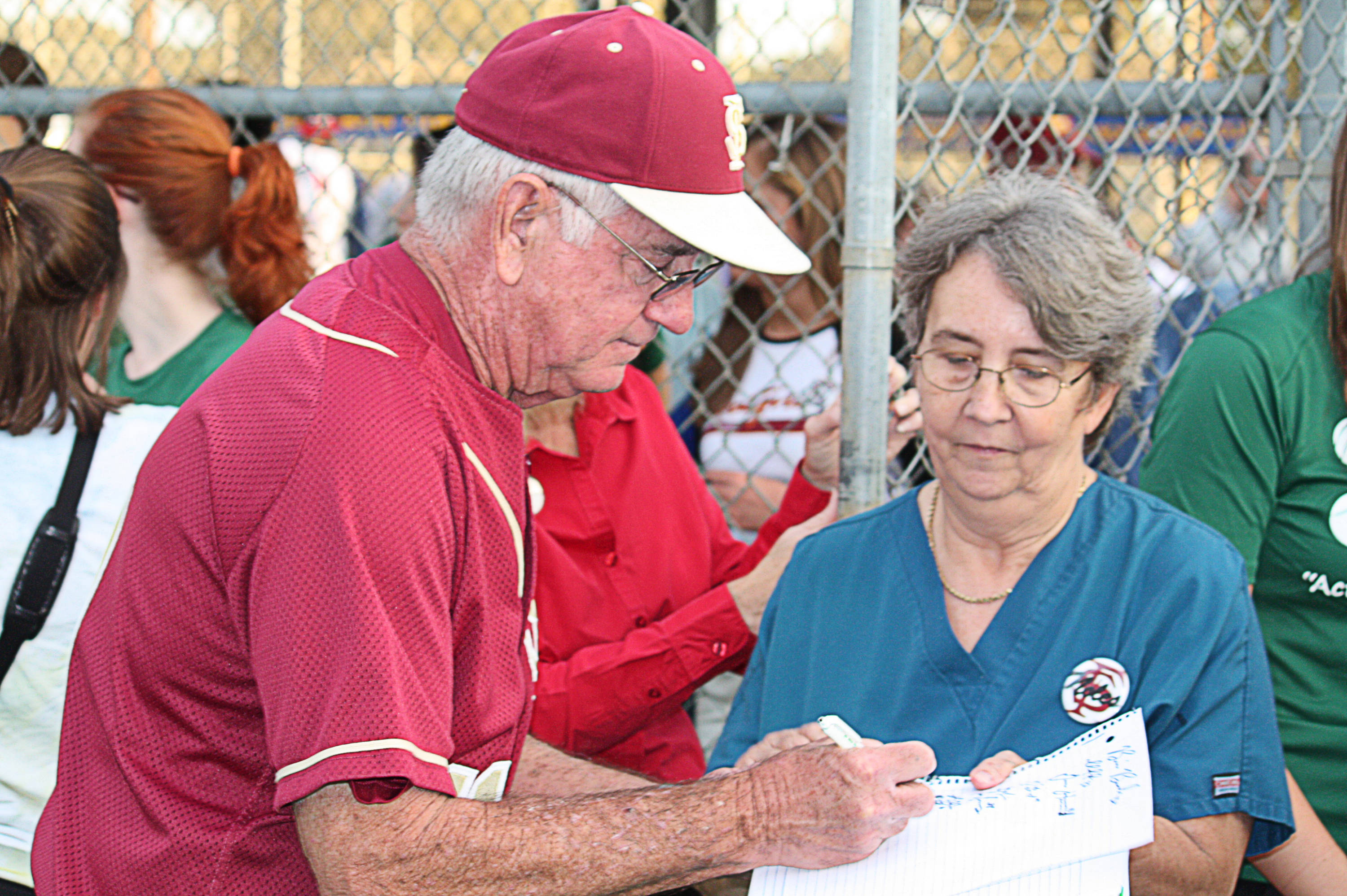 Mike Martin (11) signs an autograph