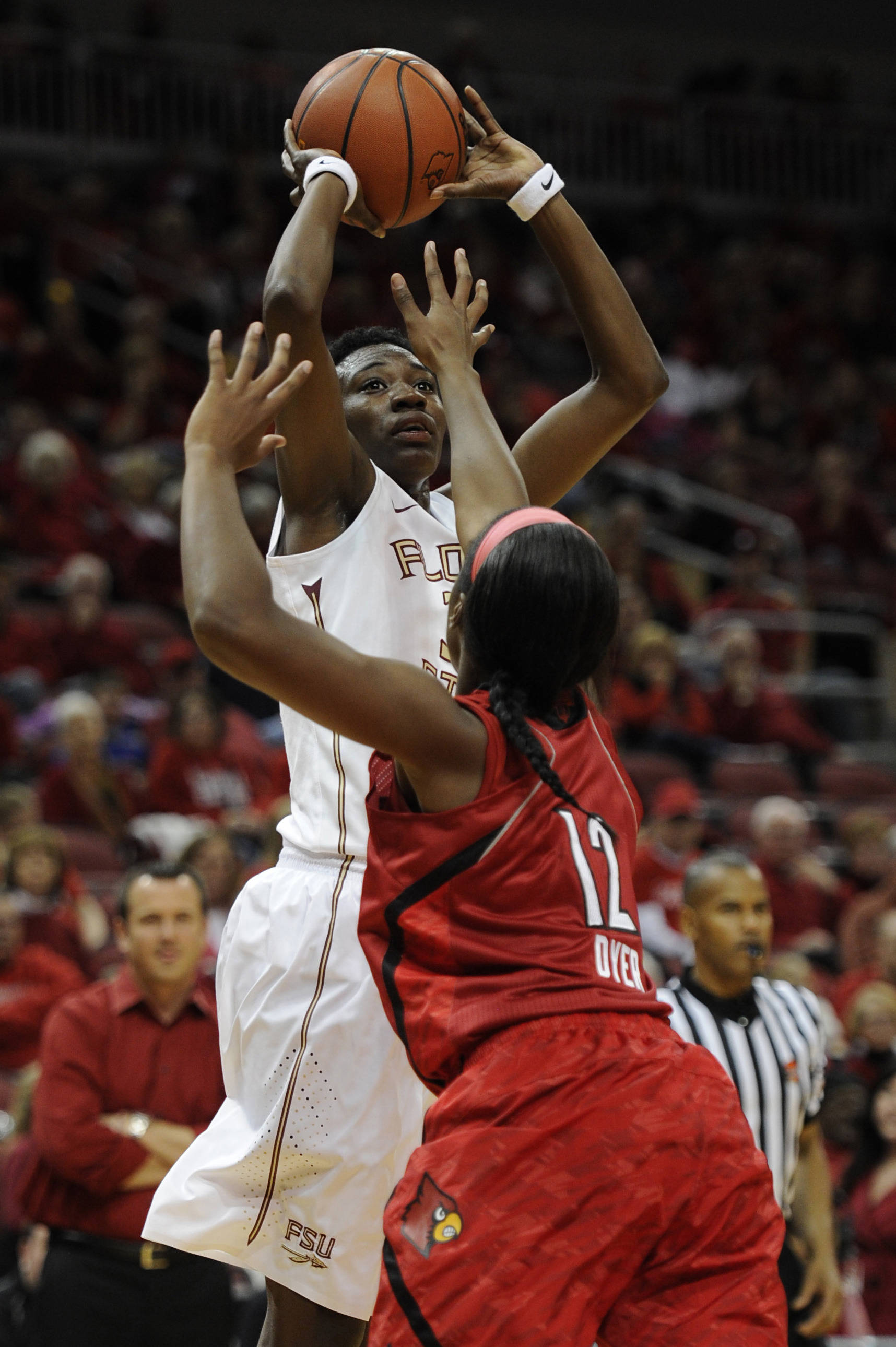 Nov 24, 2013; Louisville, KY, USA; Florida State Seminoles forward Natasha Howard (33) shoots the ball in front of Louisville Cardinals forward Shawnta' Dyer (12) during the first half at KFC YUM! Center. Mandatory Credit: Jamie Rhodes-USA TODAY Sports