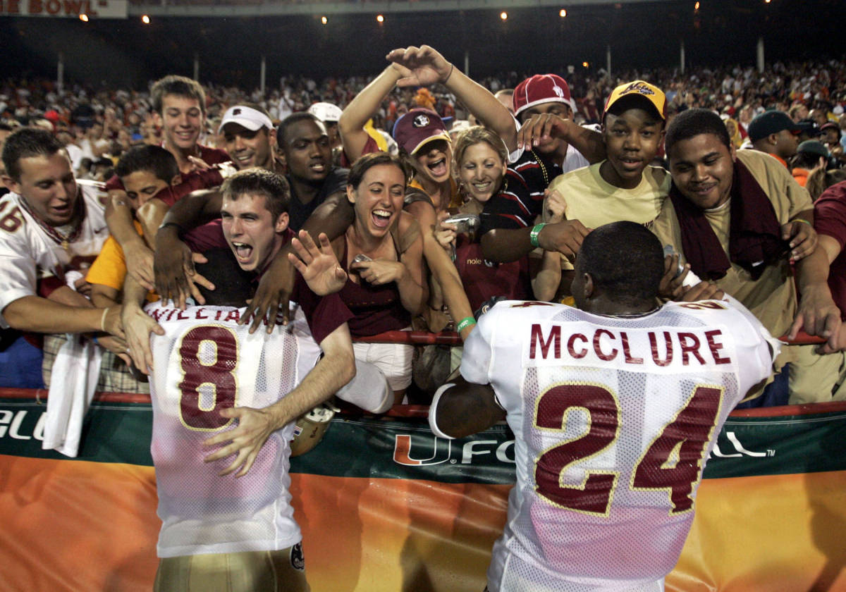 Florida State's Roger Williams, left, and Darius McClure celebrate with fans after they won the football game against Miami 13-10 Monday, Sept. 4, 2006, at the Orange Bowl in Miami. (AP Photo/Miami Herald, Al Diaz)