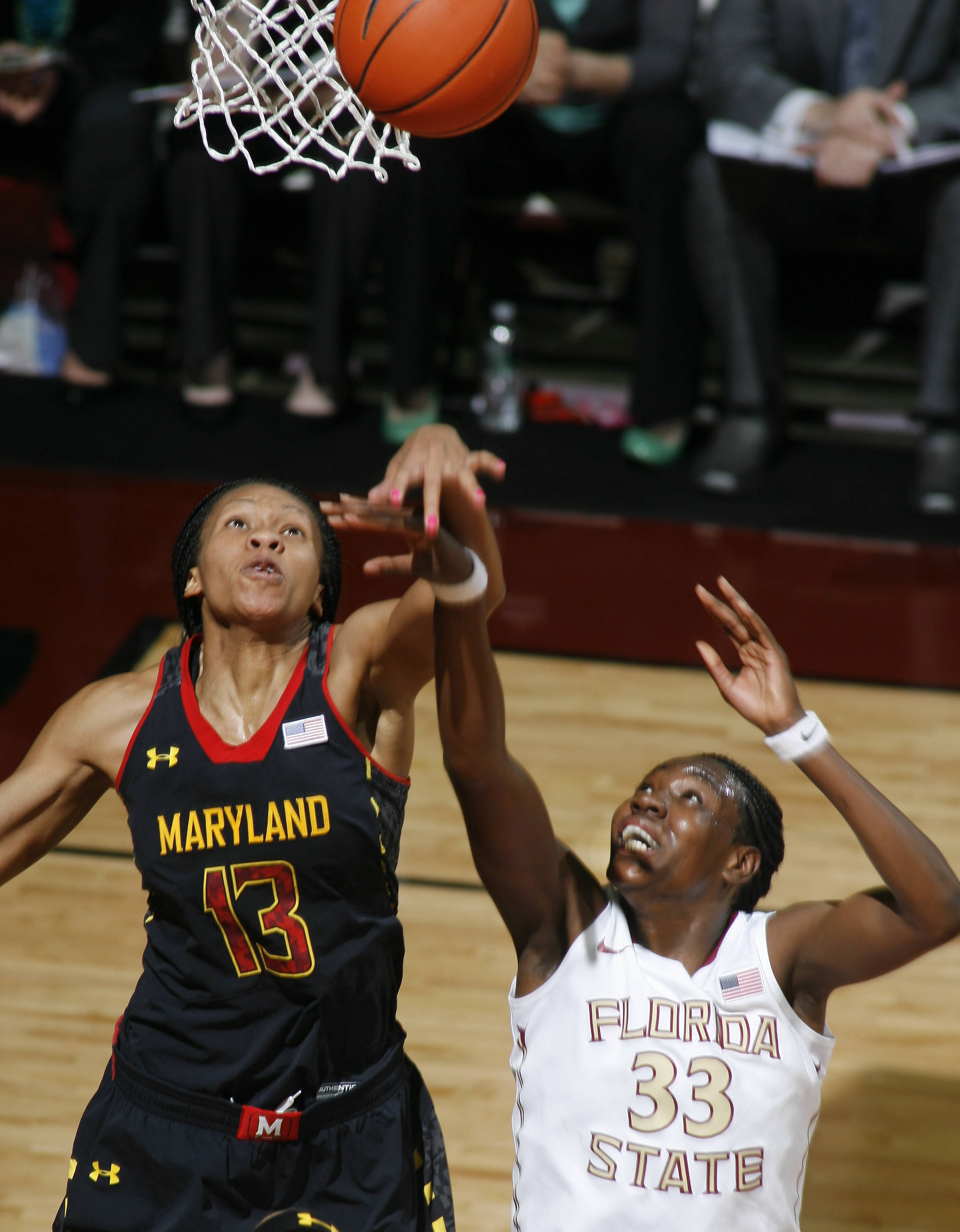 Maryland center Alicia DeVaughn (13) fouls Florida State forward Natasha Howard (33) on a layup-attempt in the first half. (AP Photo/Phil Sears)