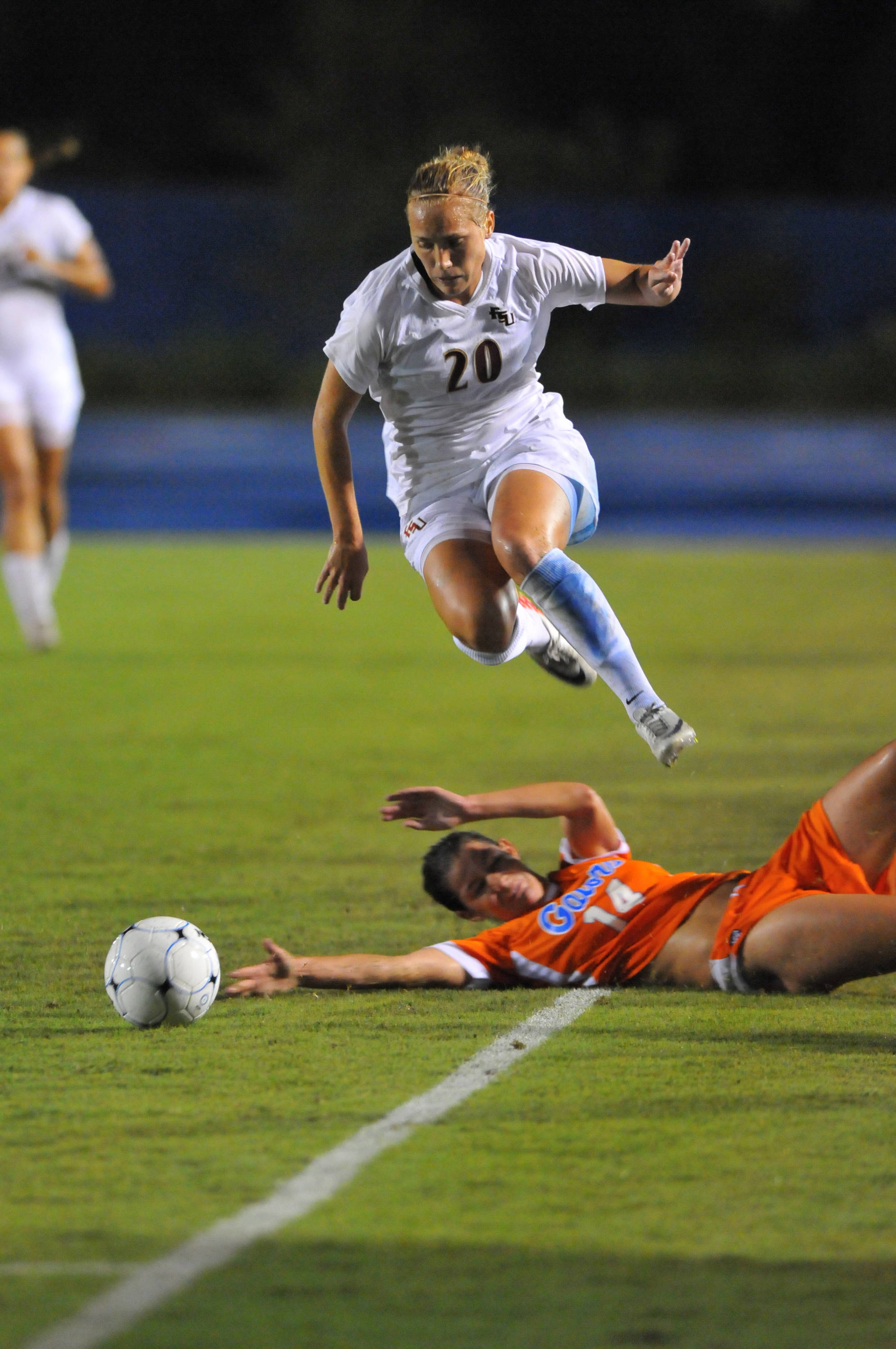 Janice Cayman hurdles a Gator player during a run down the sideline in the second half.