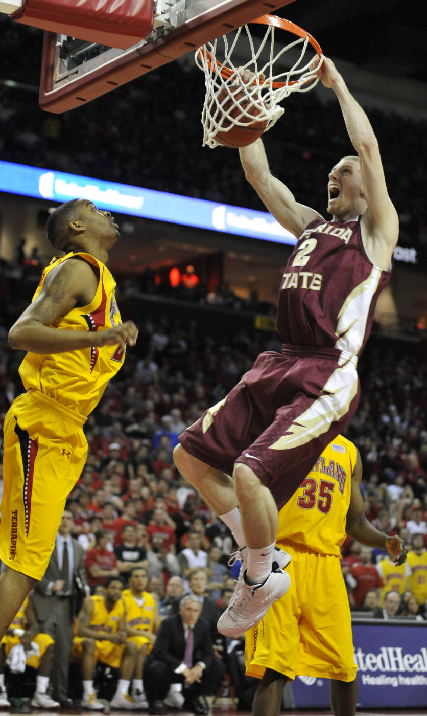 Florida State's Jordan DeMercy dunks in front of Maryland's Cliff Tucker, left in the first half of an NCAA college basketball game, Sunday, Jan. 10, 2010, in College Park, Md. Maryland won 77-68. (AP Photo/Gail Burton)