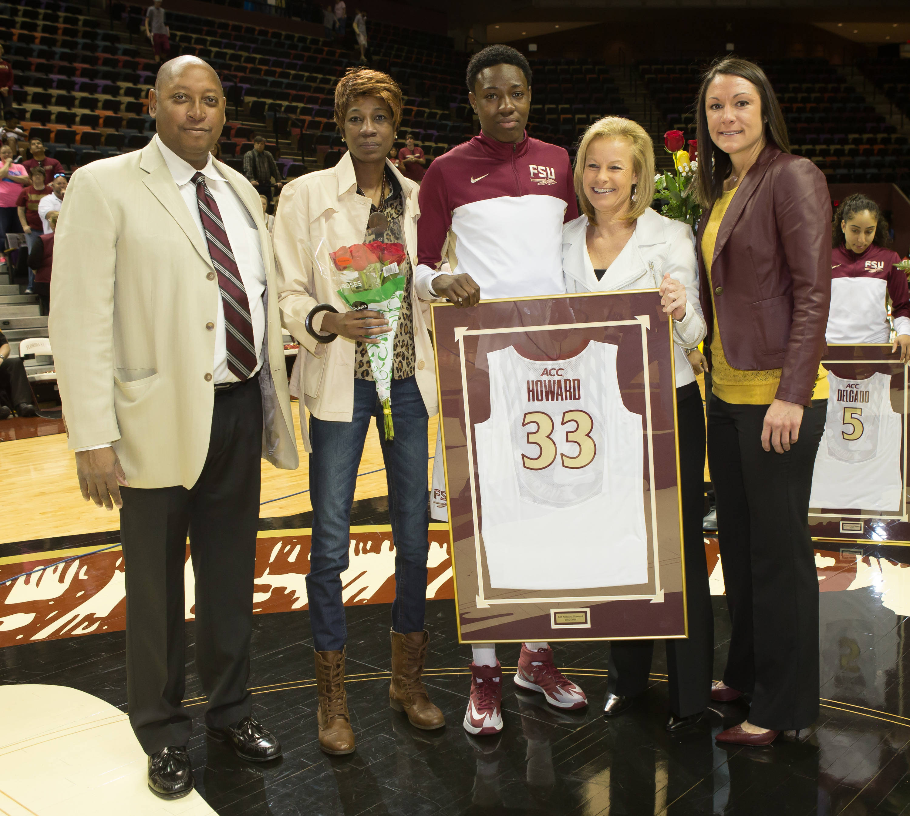 Athletic Director Stan Wilcox, SWA Vanessa Fuchs, and Coach Sue Semrau recognize Senior Natasha Howard (33).