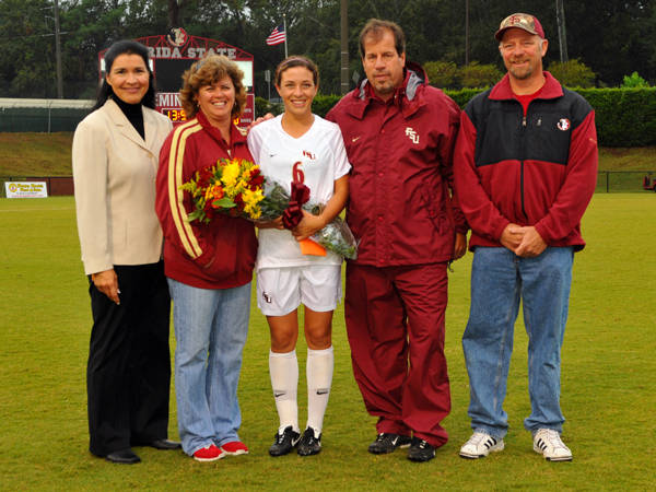 Kellie Elliott and Mark Krikorian with Erika Sutton and her mom and dad.