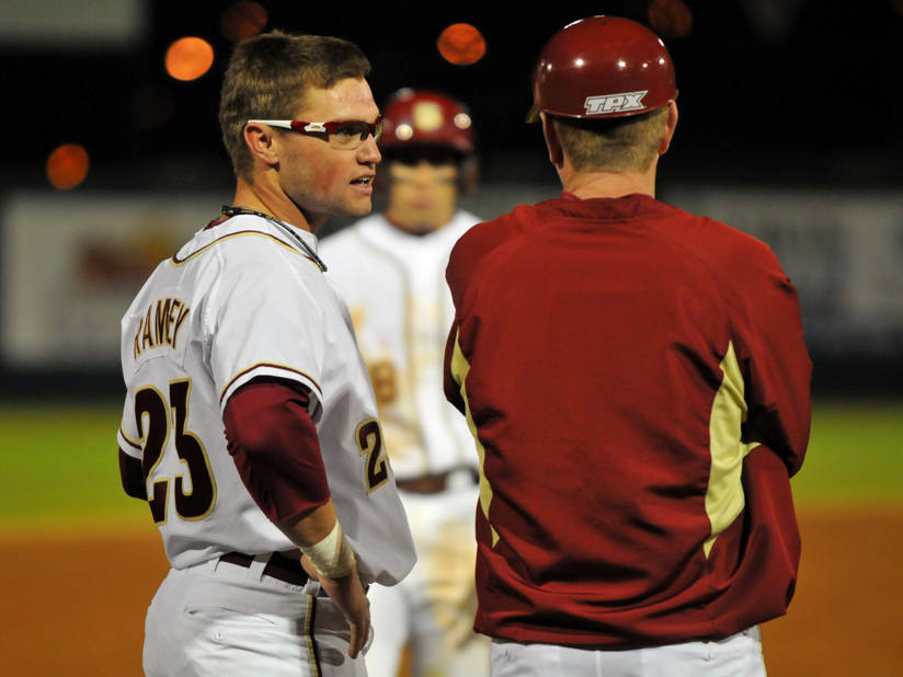 James Ramsey talks at third base with assistant coach Mike Martin, Jr.