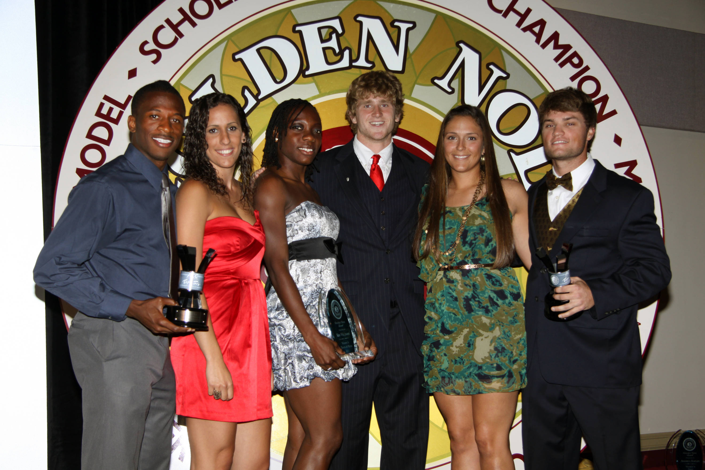 Ashley Stager stands with more Golden Nole Award winners