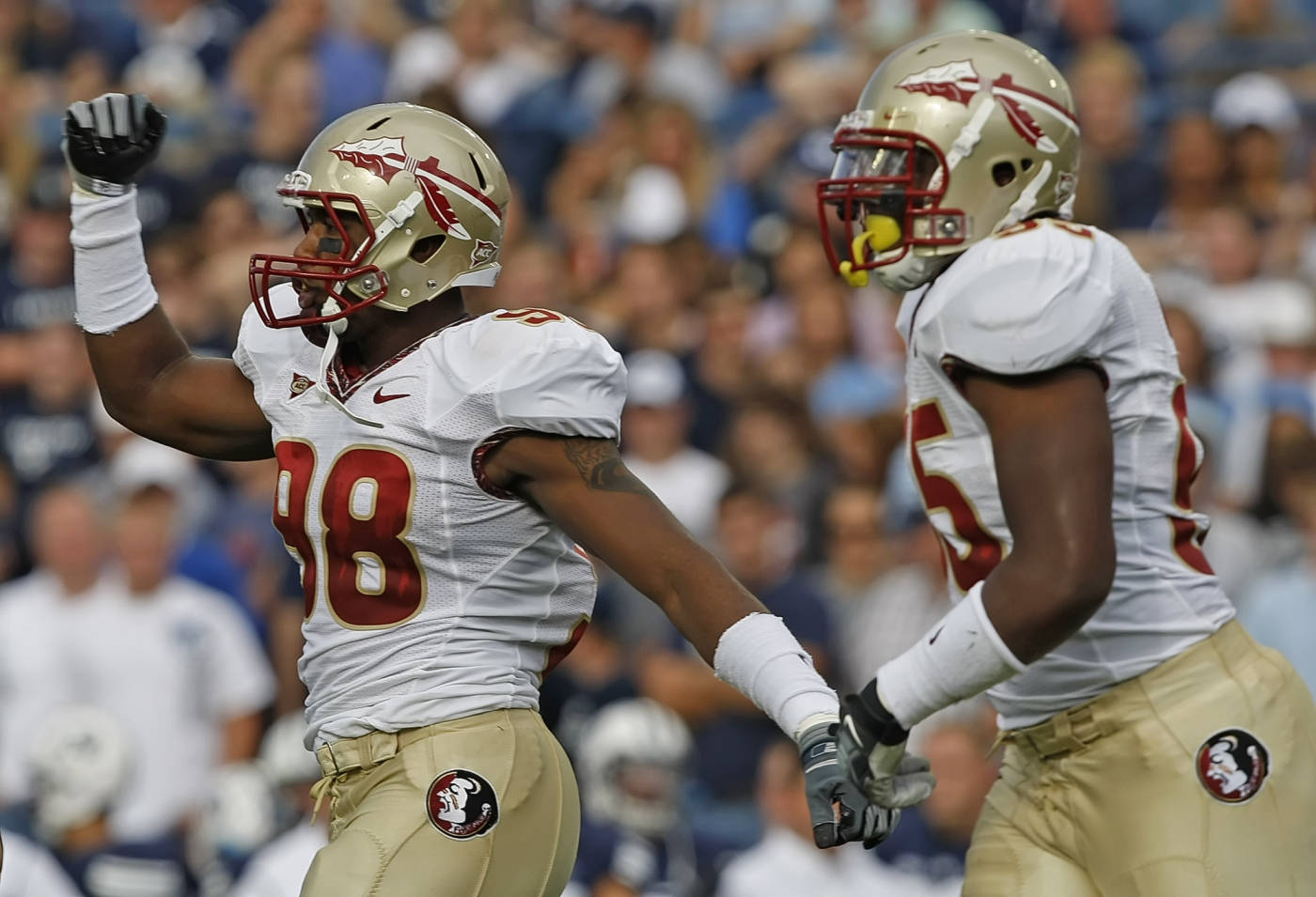 Florida State's Beau Reliford, left and Ja'Baris Little celebrate a touchdown against BYU during a NCAA football game at LaVell Edwards Stadium in Provo, Utah, Saturday, Sept. 19, 2009. (AP Photo/George Frey)
