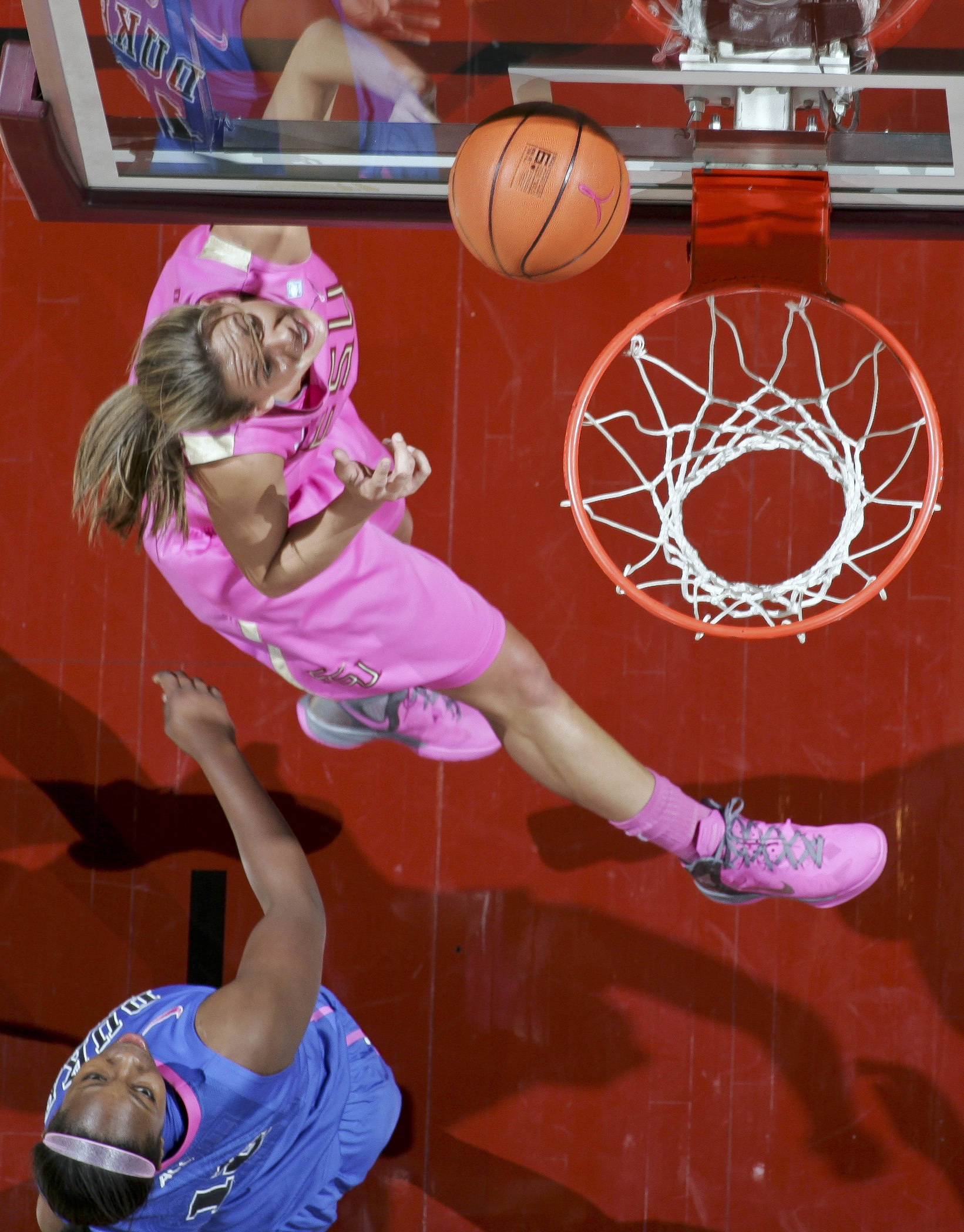 Florida State's Alexa Deluzio, top, makes a layup after getting past Duke's Chelsea Gray. (AP Photo/Phil Sears)