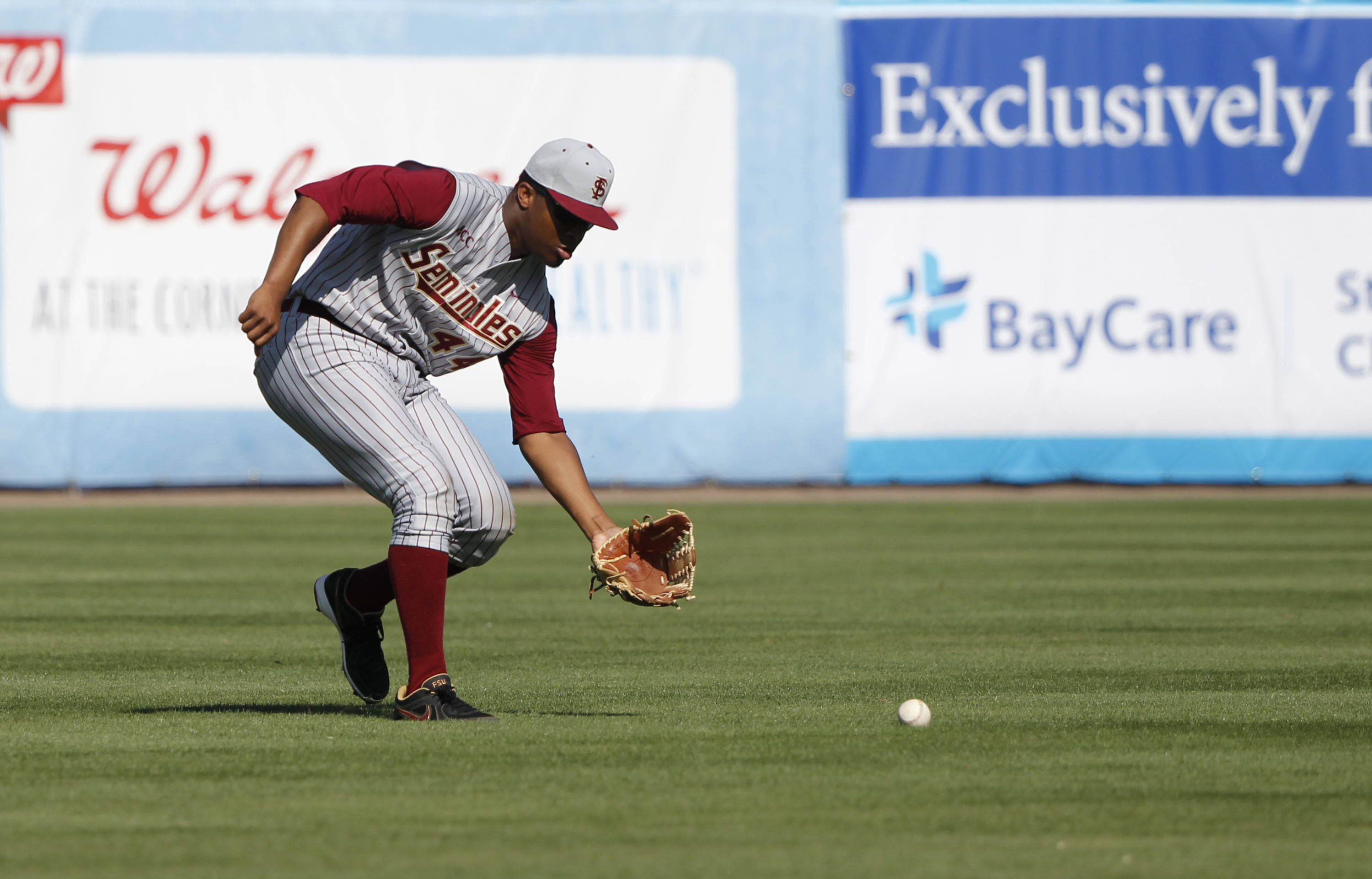 Feb 25, 2014; Tampa, FL, USA; Florida State Seminoles pitcher/outfielder Jameis Winston (44) grounds the ball during the sixth inning against the New York Yankees at George M. Steinbrenner Field. Mandatory Credit: Kim Klement-USA TODAY Sports