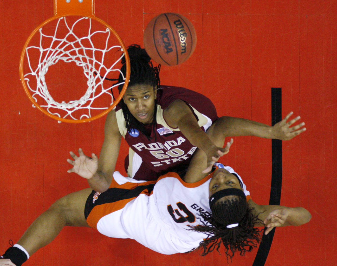 Oklahoma State's Danielle Green shoots over Florida State's Jacinta Monroe, top, during the first half of an NCAA women's basketball tournament game, Monday, March 24, 2008, in Des Moines, Iowa. (AP Photo/Charlie Neibergall)