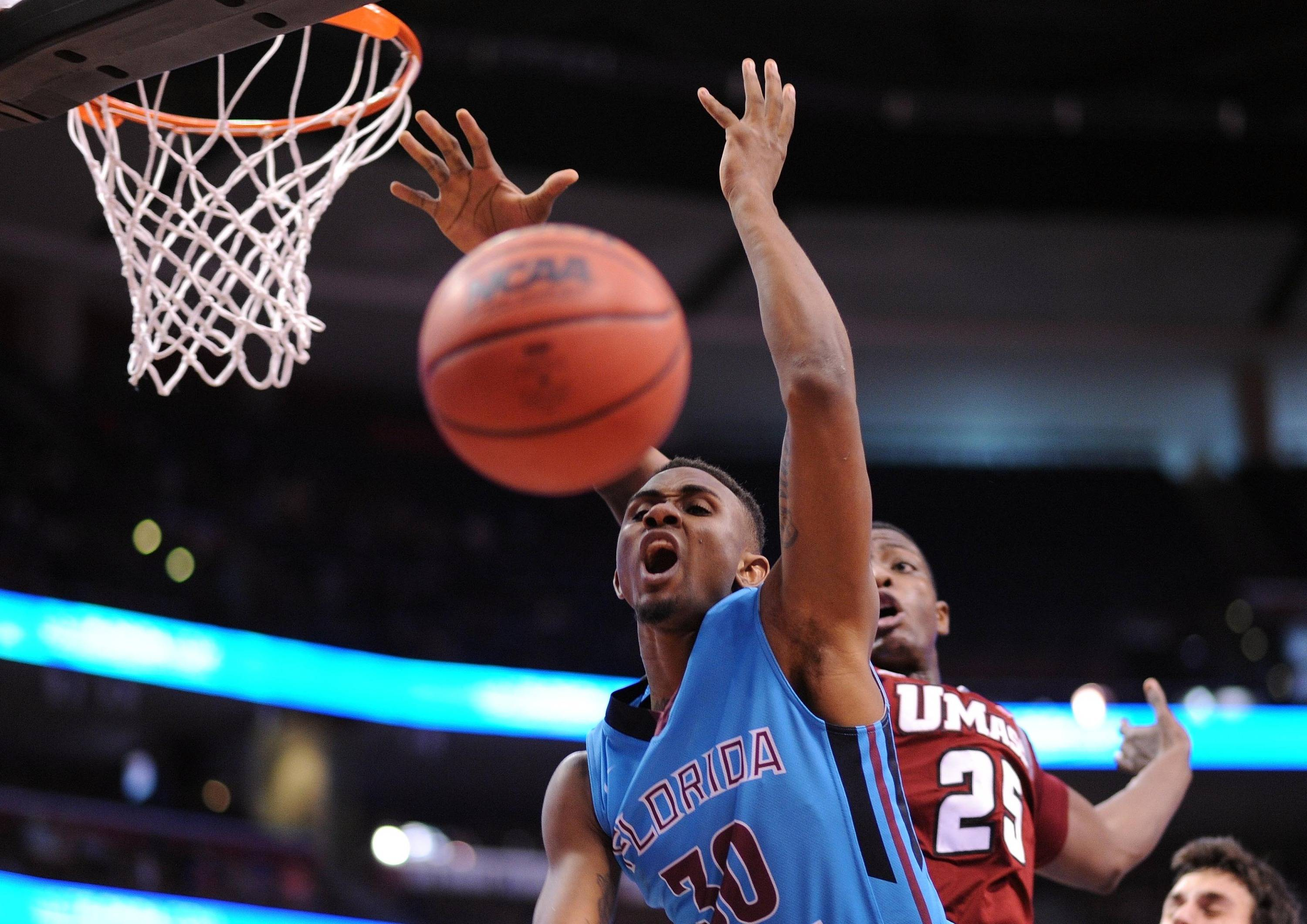 Dec 21, 2013; Sunrise, FL, USA; Florida State Seminoles guard Ian Miller (30) is fouled by Massachusetts Minutemen center Cady Lalanne (25) during the first half at BB&T Center. Mandatory Credit: Steve Mitchell-USA TODAY Sports