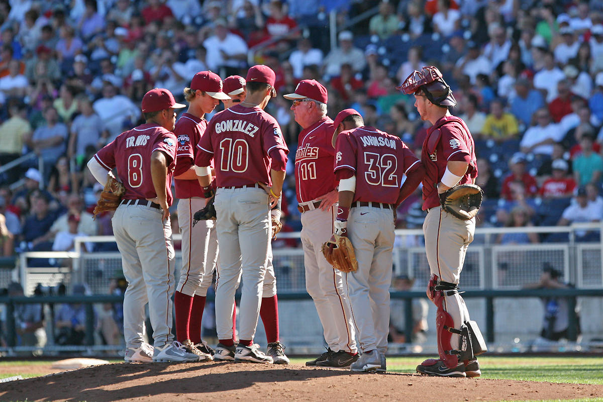 Head coach Mike Martin meets at home plate with the Seminoles.