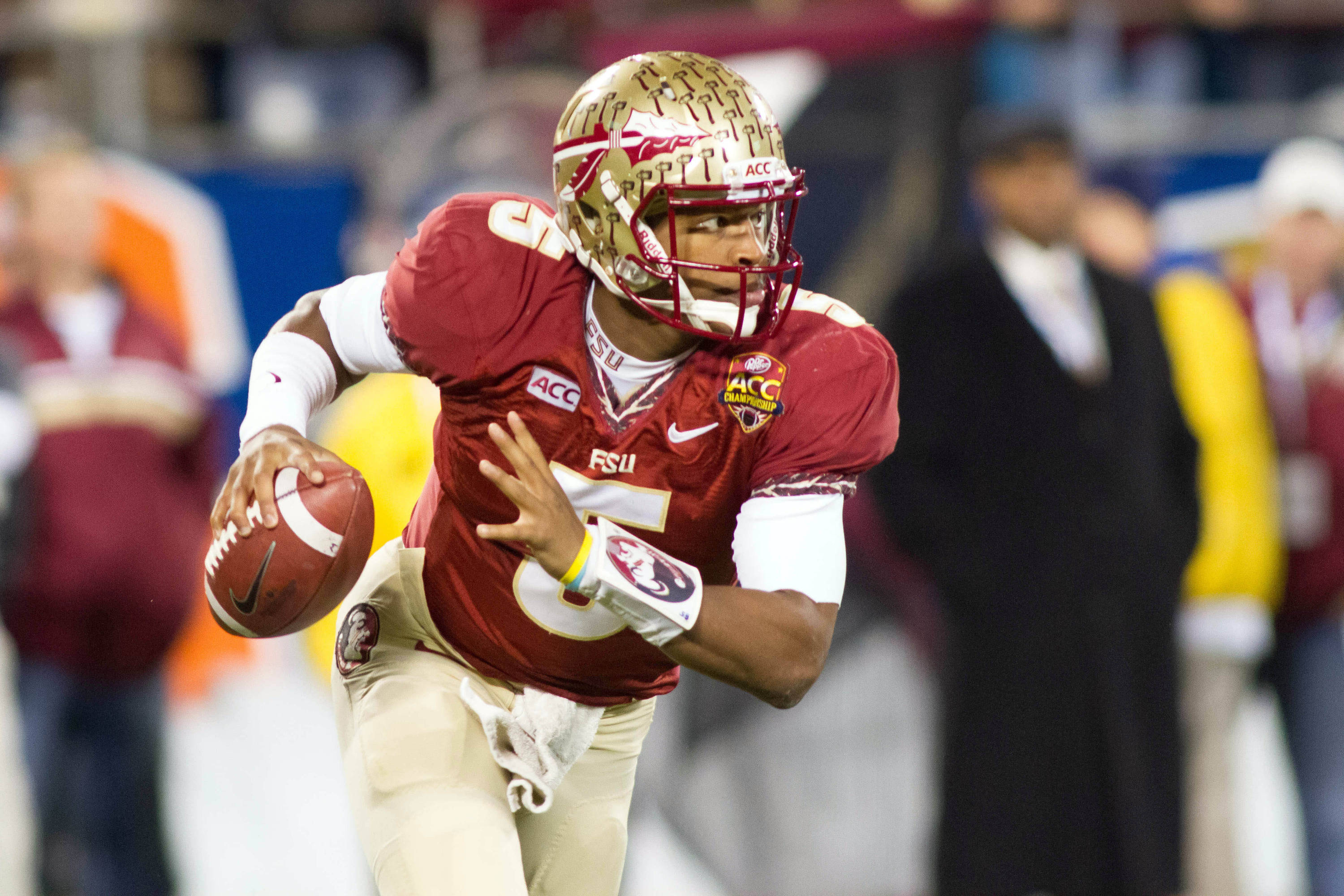 Dec 7, 2013; Charlotte, NC, USA; Florida State Seminoles quarterback Jameis Winston (5) runs the ball during the first quarter against the Duke Blue Devils at Bank of America Stadium. Mandatory Credit: Jeremy Brevard-USA TODAY Sports