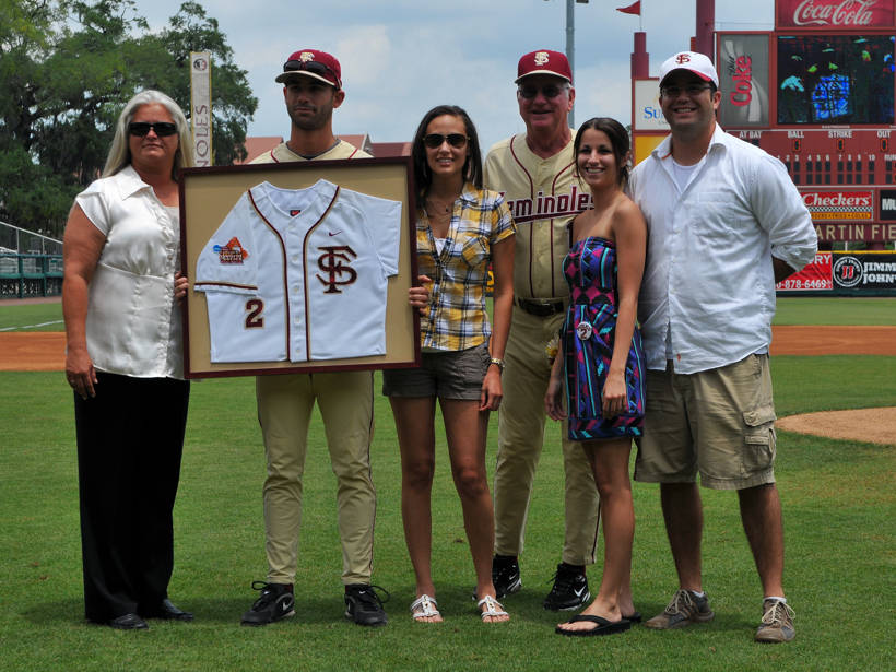 Ohmed Danesh  with family and head coach Mike Martin on Senior Day.