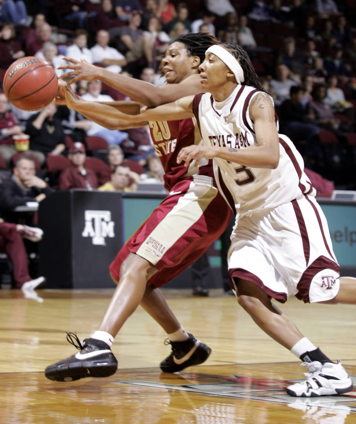 Texas A&M's Takia Starks, left, goes for the steal on an inbound pass to Florida State's Tanae Davis-Cain during the first half of a basketball game Thursday, Dec. 6, 2007, in College Station, Texas. (AP Photo/Paul Zoeller)