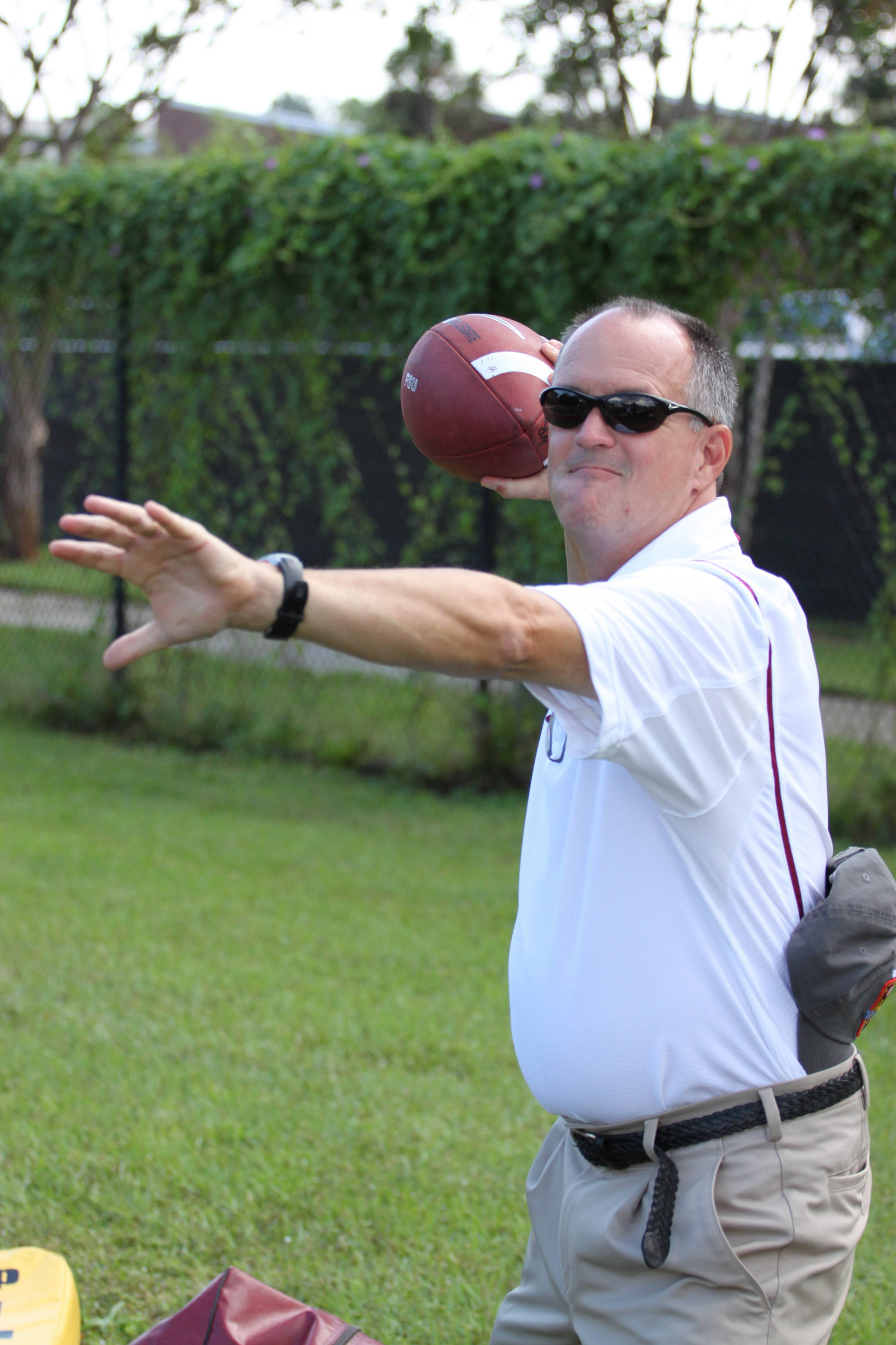 Football SID Bob Thomas is all in at practice.