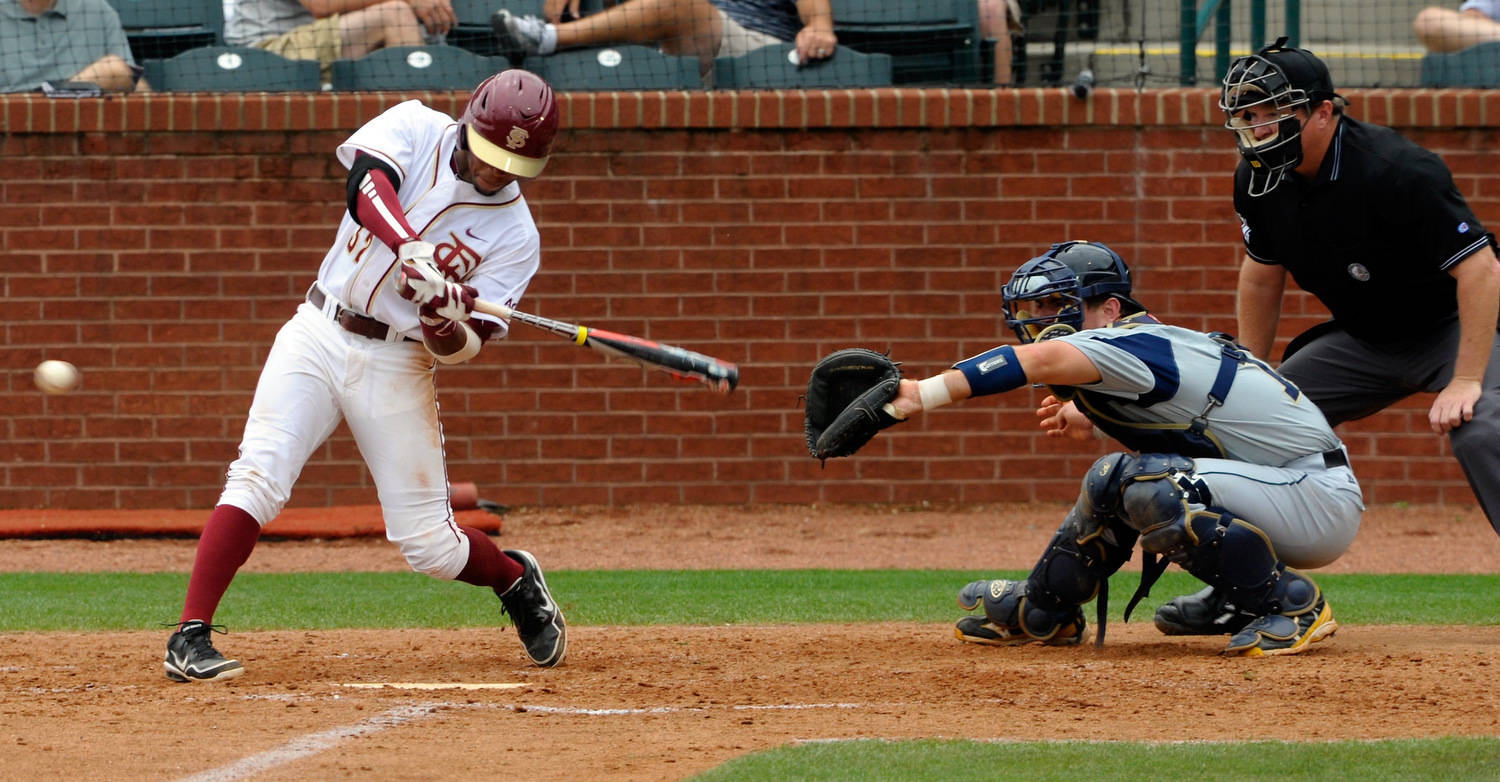 Florida State's Sheman Johnson (32) bats as Georgia Tech's A.J. Murray (9) catches during the ACC Baseball Championship May 23, 2012 in Greensboro, N.C. (Photo by Sara D. Davis/theACC.com)
