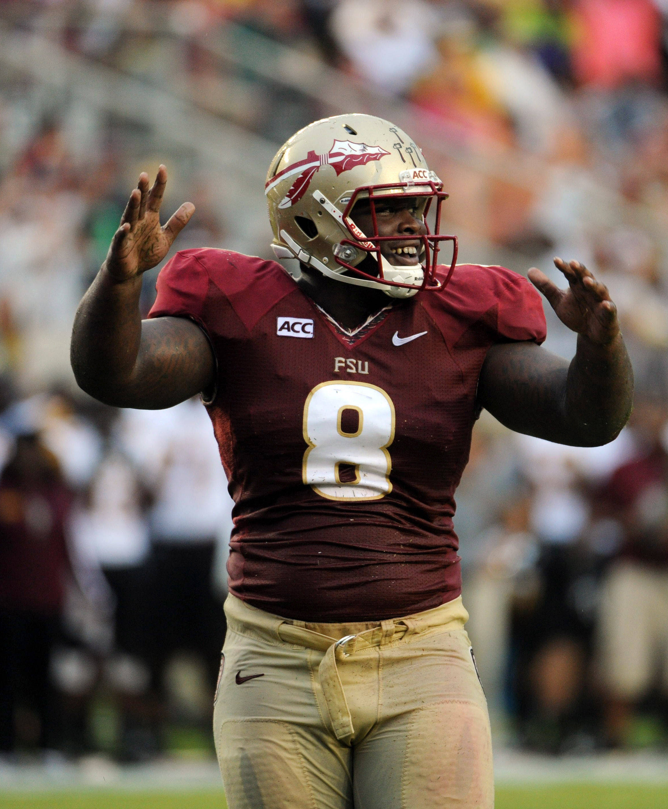 Florida State Seminoles defensive tackle Timmy Jernigan (8) celebrates a safety during the first half of the game against the Bethune-Cookman Wildcats. (Melina Vastola-USA TODAY Sports)