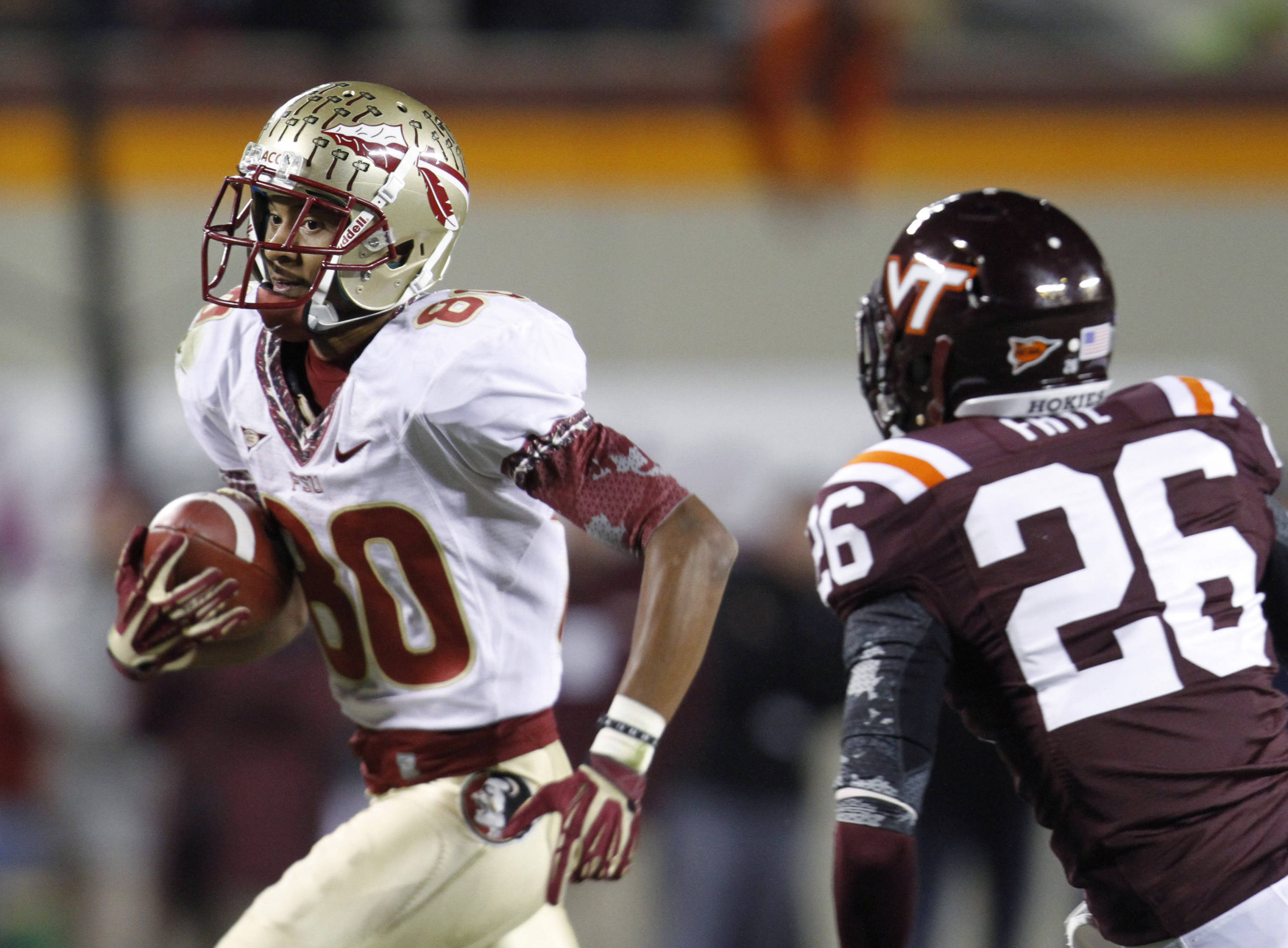 Florida State wide receiver Rashad Greene (80) heads to the end zone in front of Virginia Tech safety Desmond Frye (26) for the go-ahead touchdown. (AP Photo/Steve Helber)