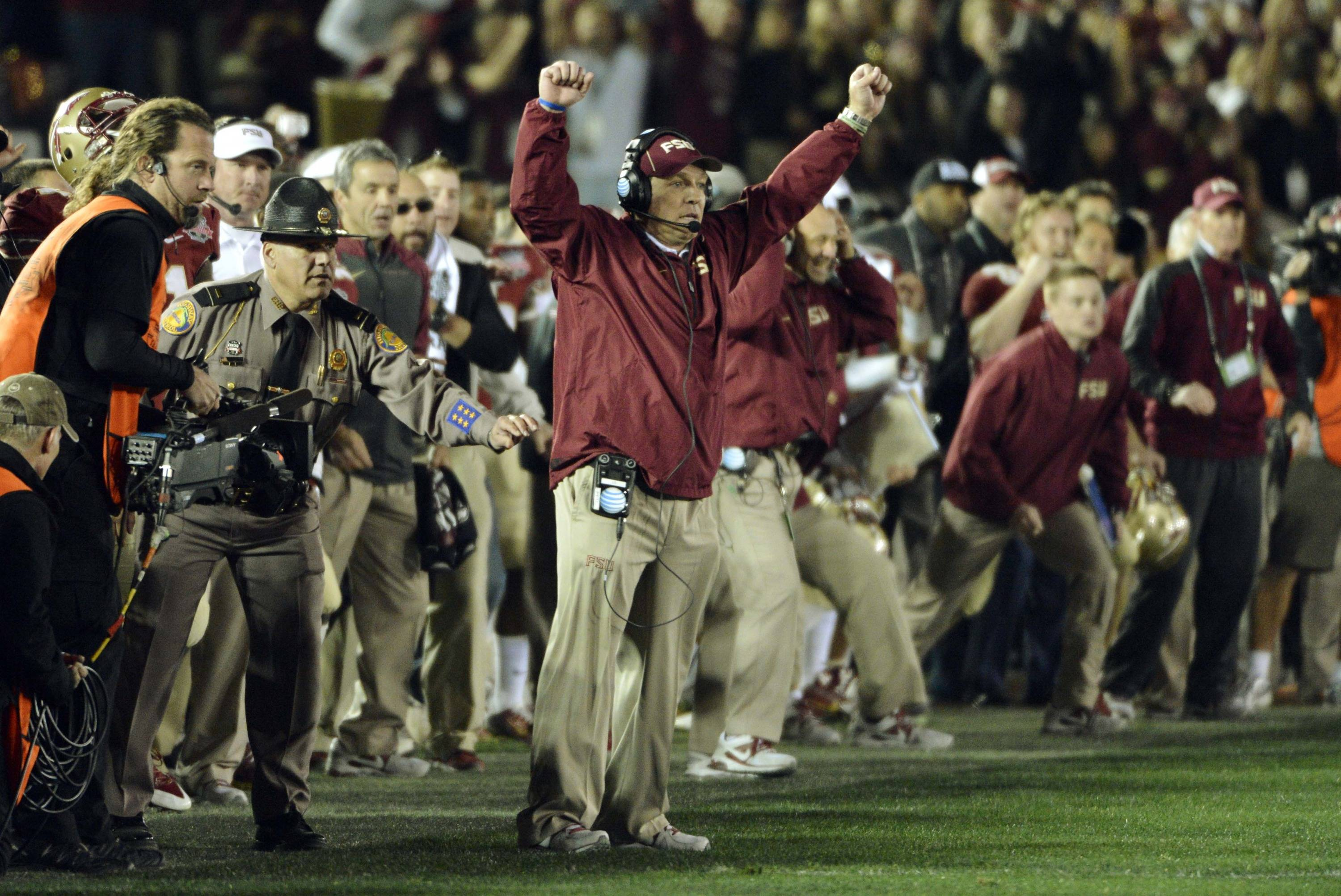 Jan 6, 2014; Pasadena, CA, USA; Florida State Seminoles head coach Jimbo Fisher celebrates with his coaches and team as time expires in the fourth quarter of the 2014 BCS National Championship game against the Auburn Tigers at the Rose Bowl.  Mandatory Credit: Robert Hanashiro-USA TODAY Sports