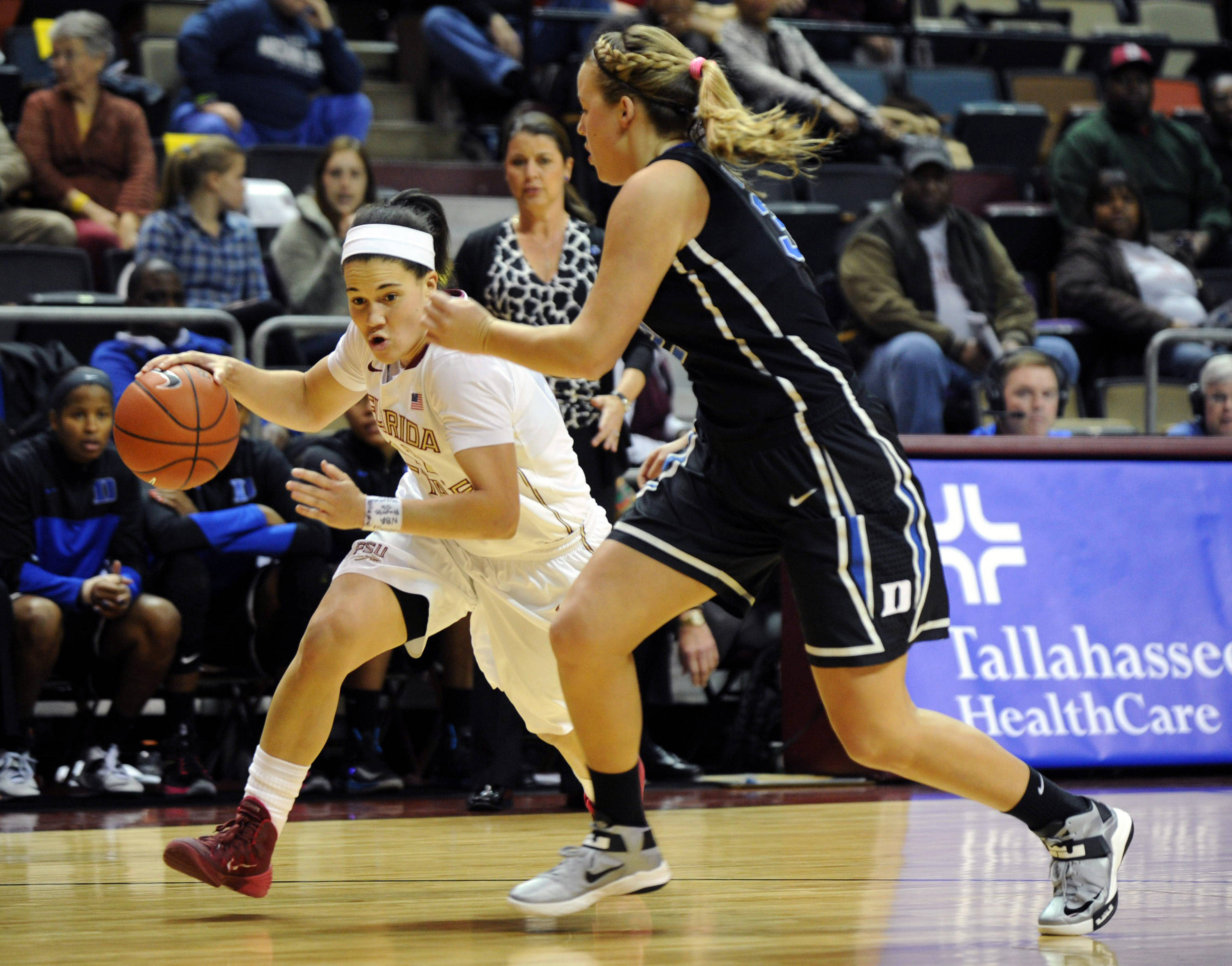 Jan 23, 2014; Tallahassee, FL, USA; Duke Blue Devils guard Tricia Liston (32) defends Florida State Seminoles guard Brittany Brown (12) during the first half of the game at the Donald L. Tucker Center (Tallahassee). Mandatory Credit: Melina Vastola-USA TODAY Sports