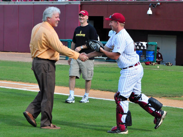 Pat Campbell, FSU scoreboard operator for 20 years, throws out the first pitch before Wednesday night's victory against FIU.