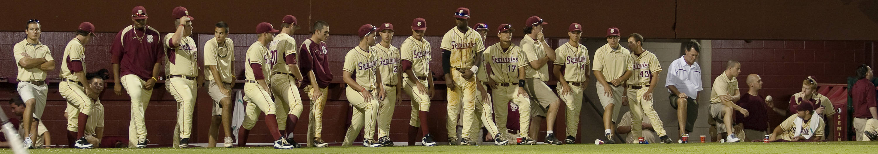 The Seminoles watch from the dugout during the final inning of the game.