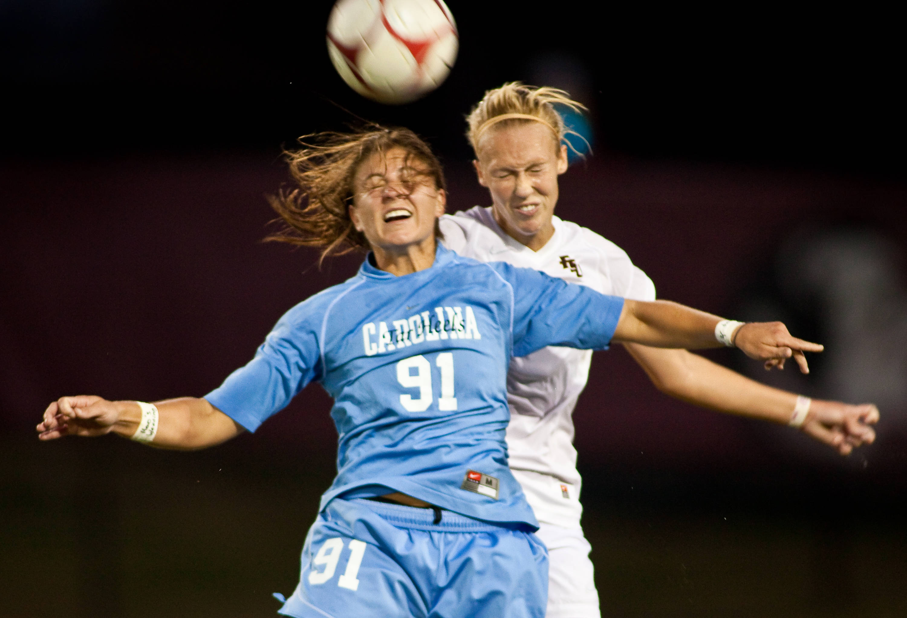 Battle for a header by FSU's Ella Stephan and UNC's Maria Lubrano