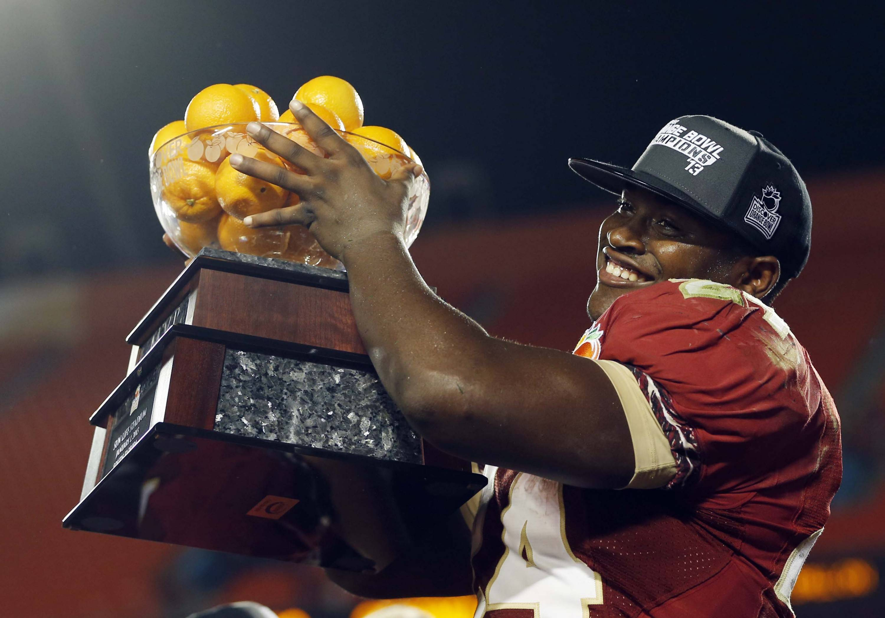 Florida State  fullback Lonnie Pryor (24) raises the MVP trophy at the Orange Bowl NCAA college football game against Northern Illinois, early Wednesday, Jan. 2, 2013, in Miami. Florida State defeated Northern Illinois 31-10. Pryor ran for a career-high 134 yards and two touchdowns. (AP Photo/Alan Diaz)