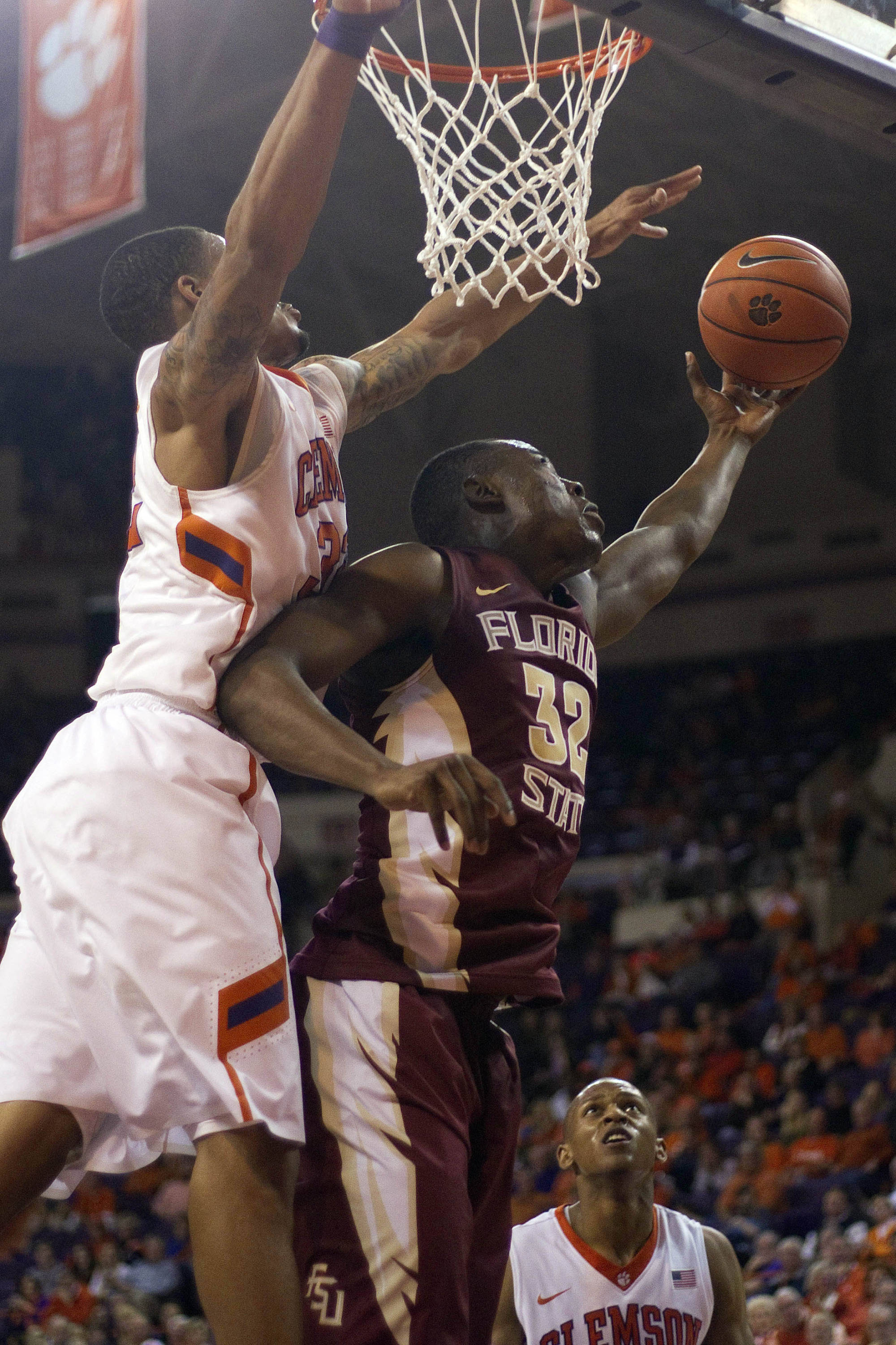 Jan 9, 2014; Clemson, SC, USA; Clemson Tigers forward K.J. McDaniels (32) blocks the shot by Florida State Seminoles guard Montay Brandon (32) during the second half at J.C. Littlejohn Coliseum. Seminoles won 56-41. Mandatory Credit: Joshua S. Kelly-USA TODAY Sports