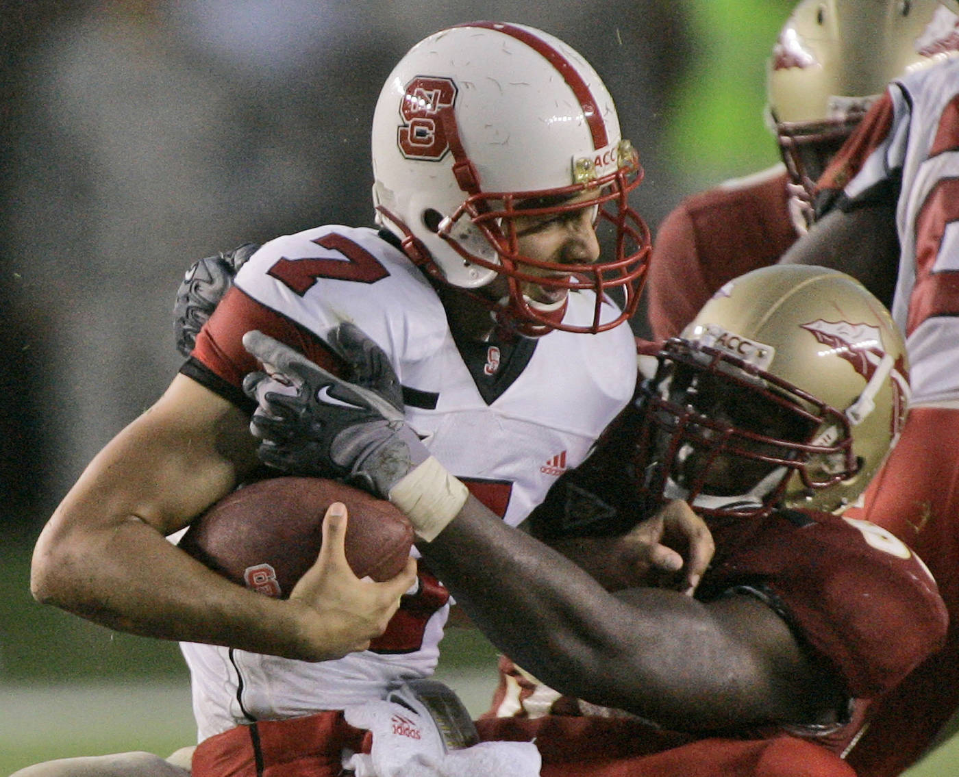 North Carolina State quarterback Daniel Evans, left, is sacked in the fourth quarter by Florida State's Everette Brown. (AP Photo/Phil Coale)