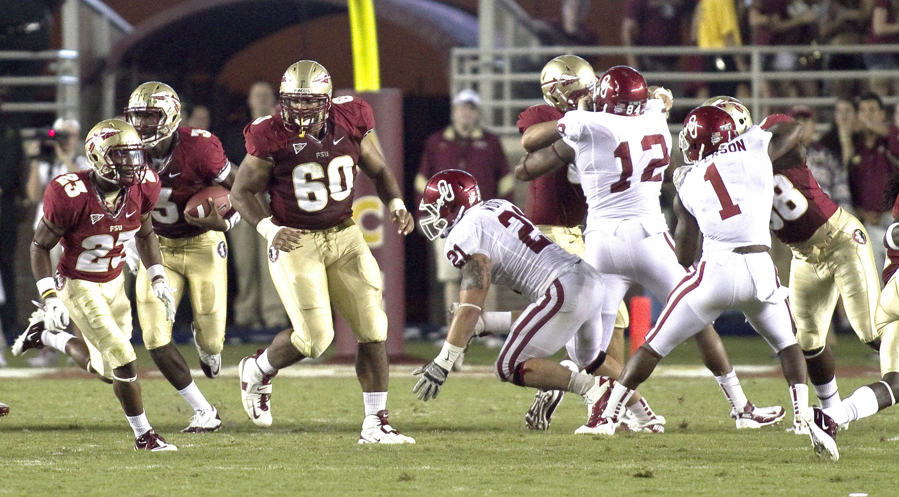 EJ Manuel (3), Chris Thompson (23), Jacob Fahrenkrug (60). FSU vs Oklahoma 9/18/11 Steve Musco