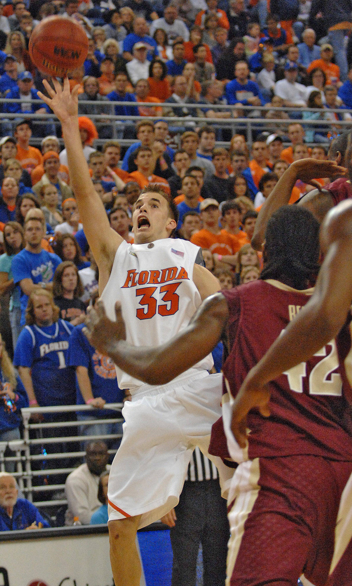 Florida's Nick Calathes (33) gets the ball away during the first half.
