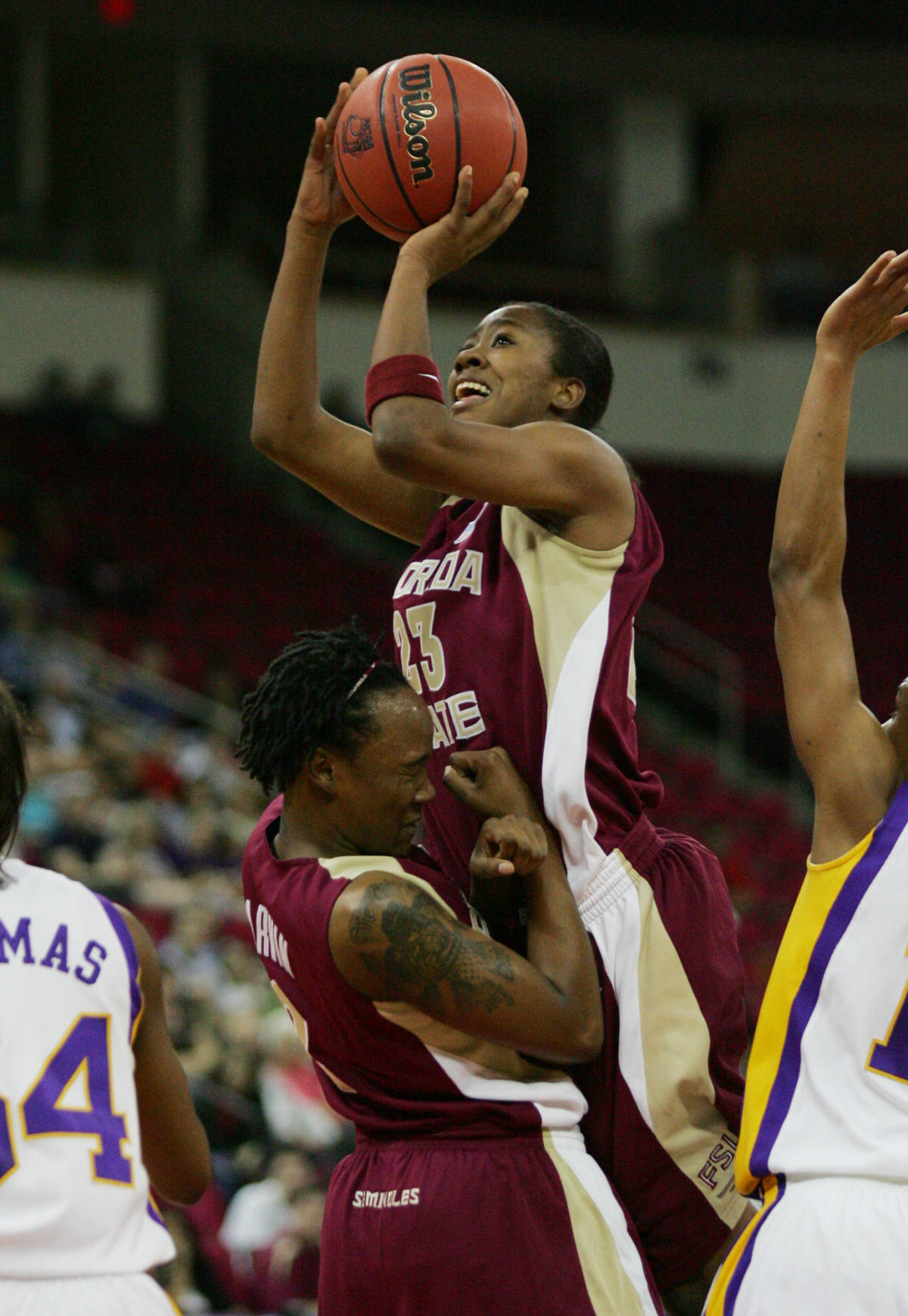 Florida State's Tiffiny Buckelew puts up a shot as she runs into teammate Alysh Harvin during the first half of a regional semifinal against Louisiana State in the NCAA women's basketball tournament in Fresno, Calif., Saturday, March 24, 2007.(AP Photo/Gary Kazanjian)