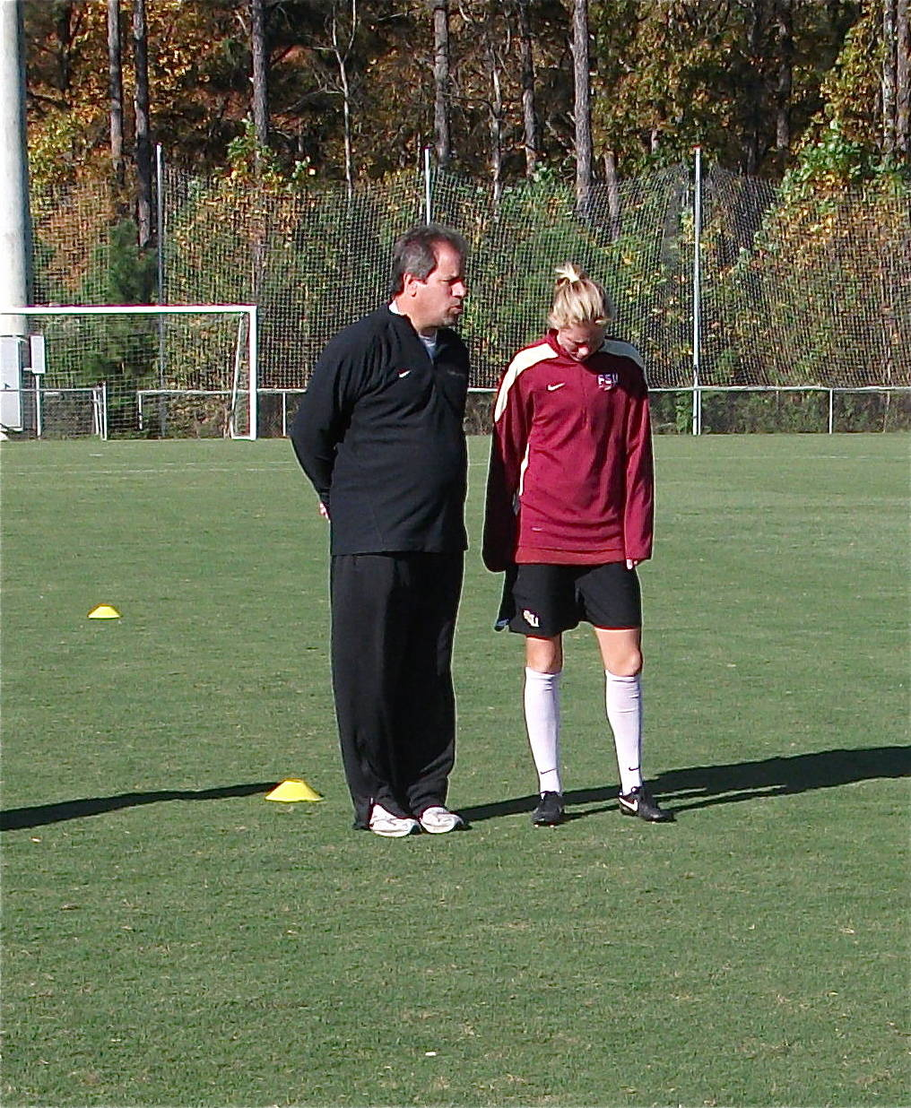 Head coach Mark Krikorian and senior midfielder Lauren Switzer
