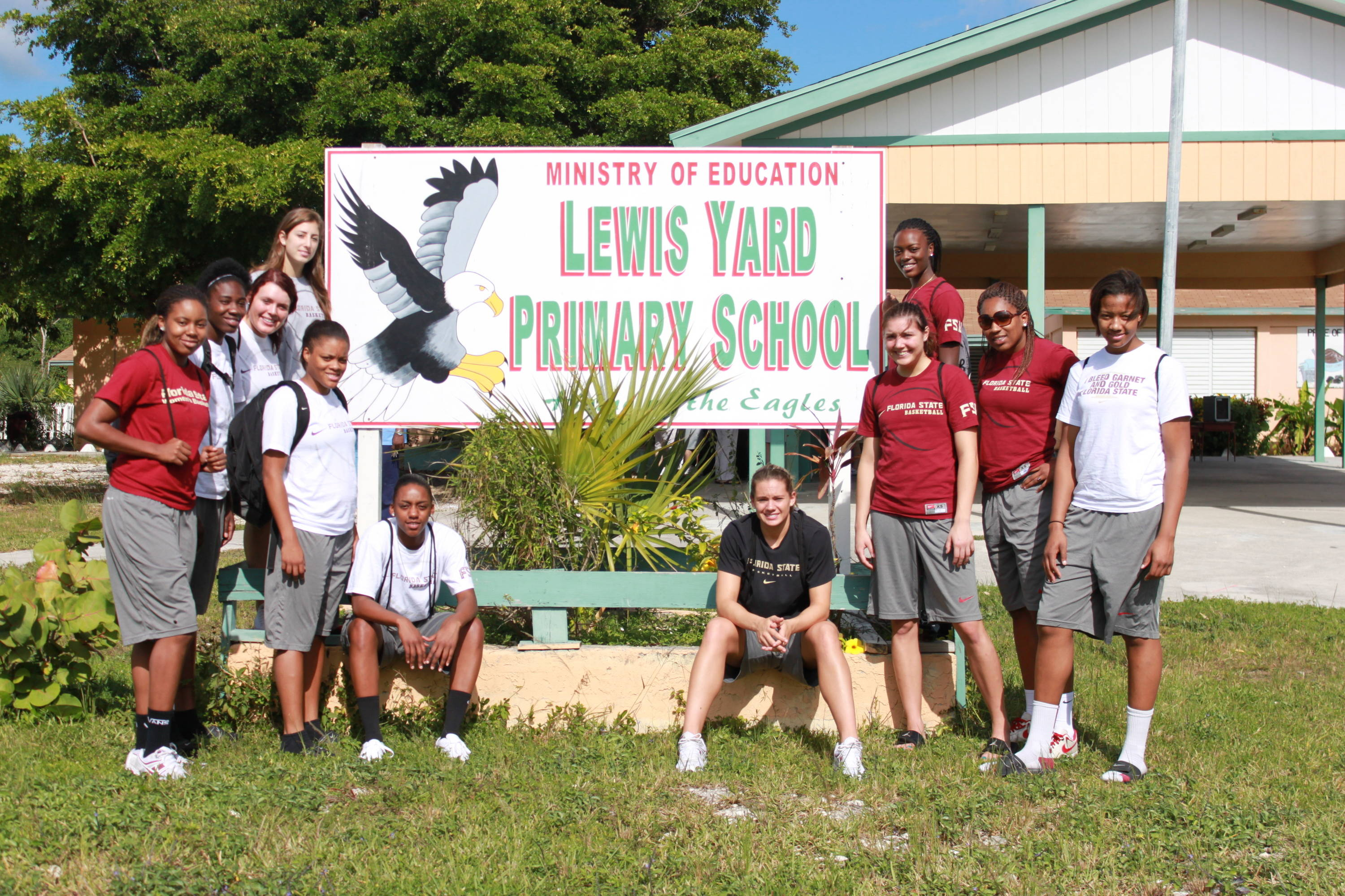 FSU players pose in front of the Lewis Yard Primary School.