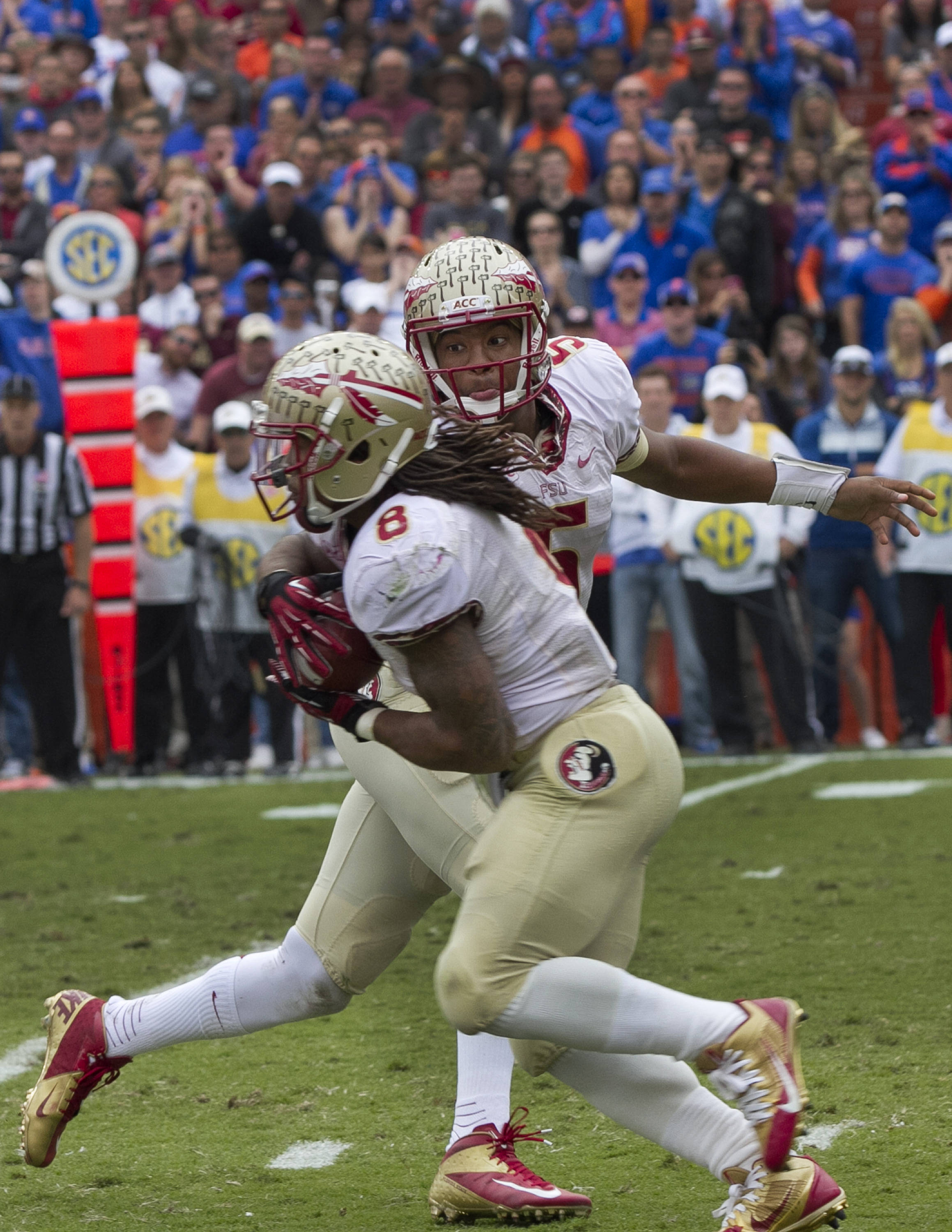 Jameis Winston (5) handing off to Devonta Freeman (8), FSU vs Florida, 11-30-13,  (Photo by Steve Musco)