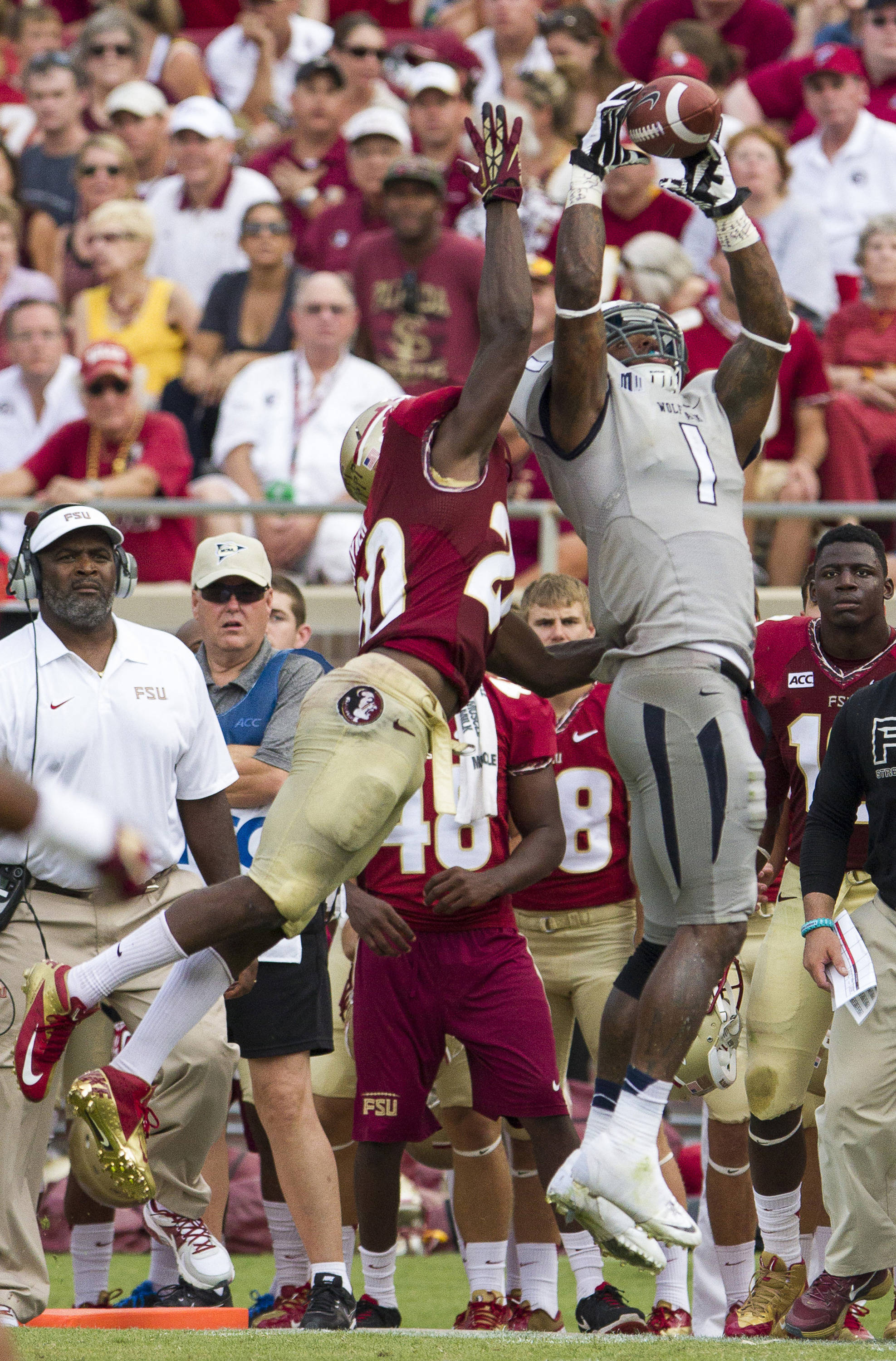 Lamarcus Joyner (20) attempts to break up a pass during FSU's 62-7 win over Nevada on Saturday, Sept 14, 2013 in Tallahassee, Fla.