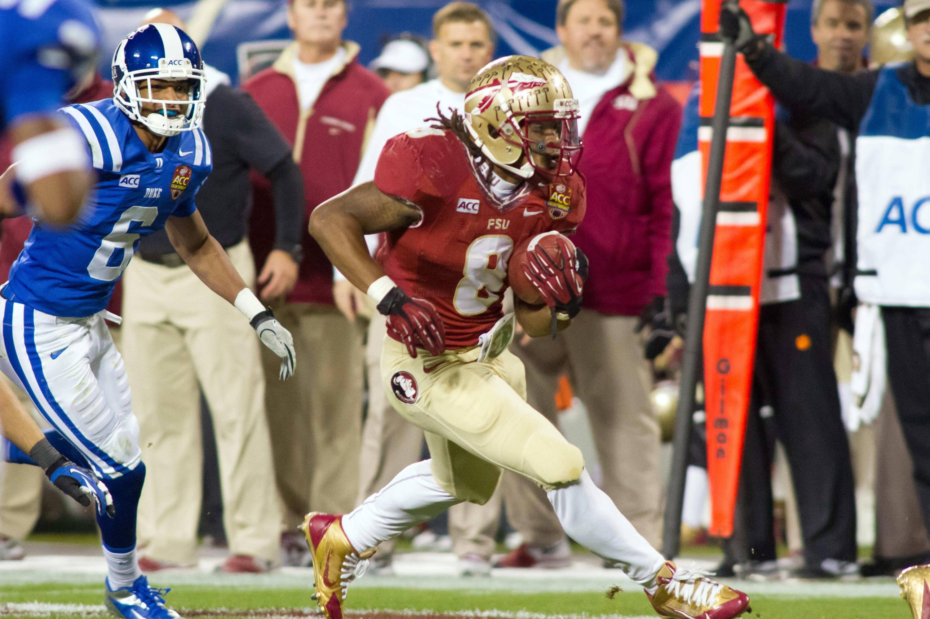 Dec 7, 2013; Charlotte, NC, USA; Florida State Seminoles running back Devonta Freeman (8) runs the ball during the first quarter against the Duke Blue Devils at Bank of America Stadium. Mandatory Credit: Jeremy Brevard-USA TODAY Sports