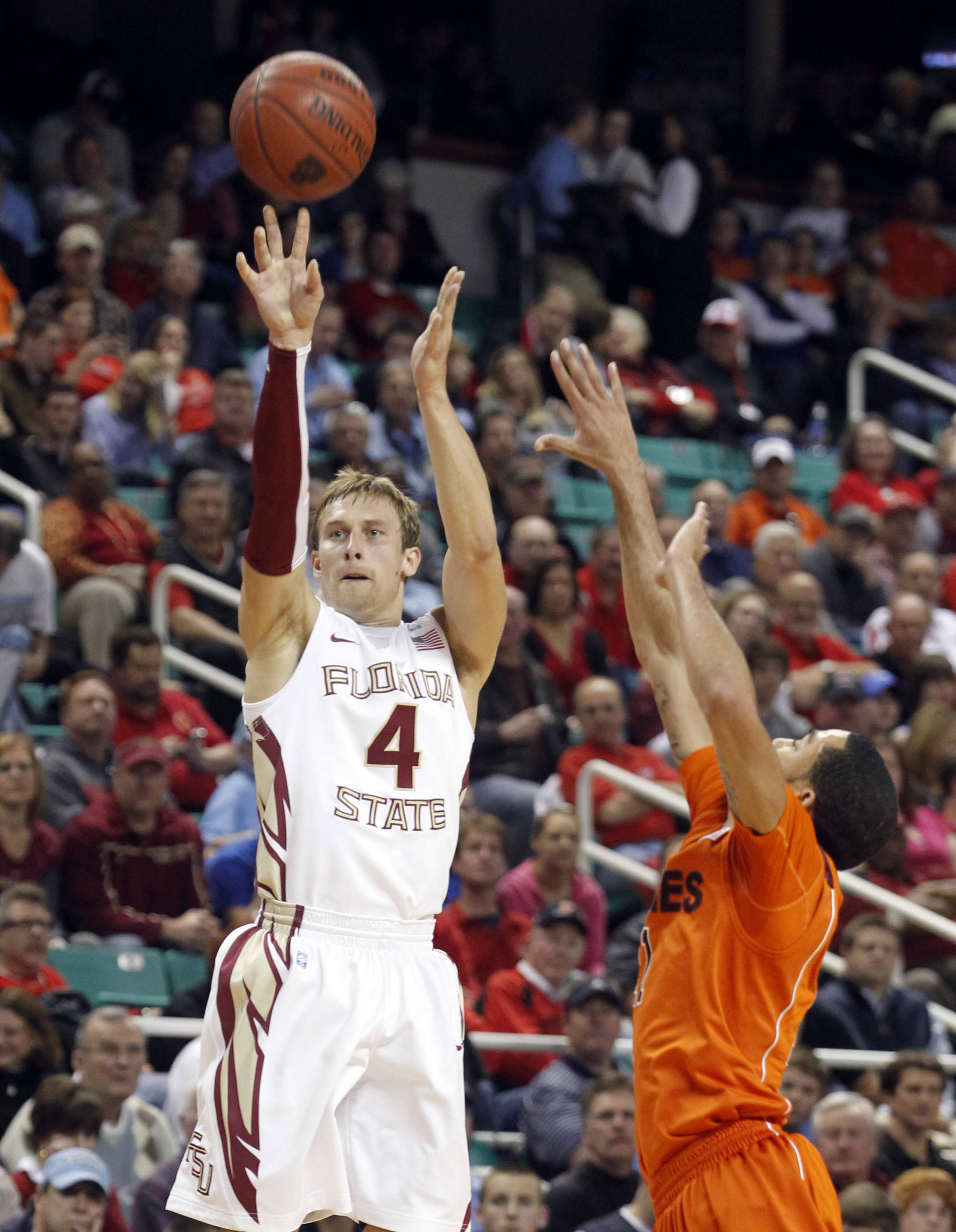 Florida State's Deividas Dulkys shoots over Virginia Tech's Erick Green. (AP Photo/Bob Leverone)