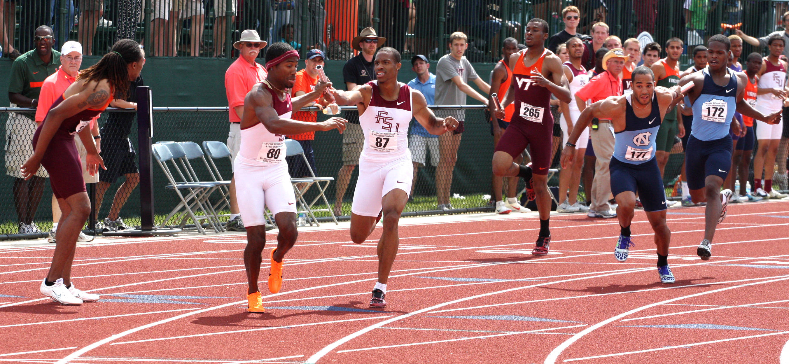 Maurice Mitchell passes the baton to Darrin Gibson for the second leg of FSU's third-place 4x400 relay team.