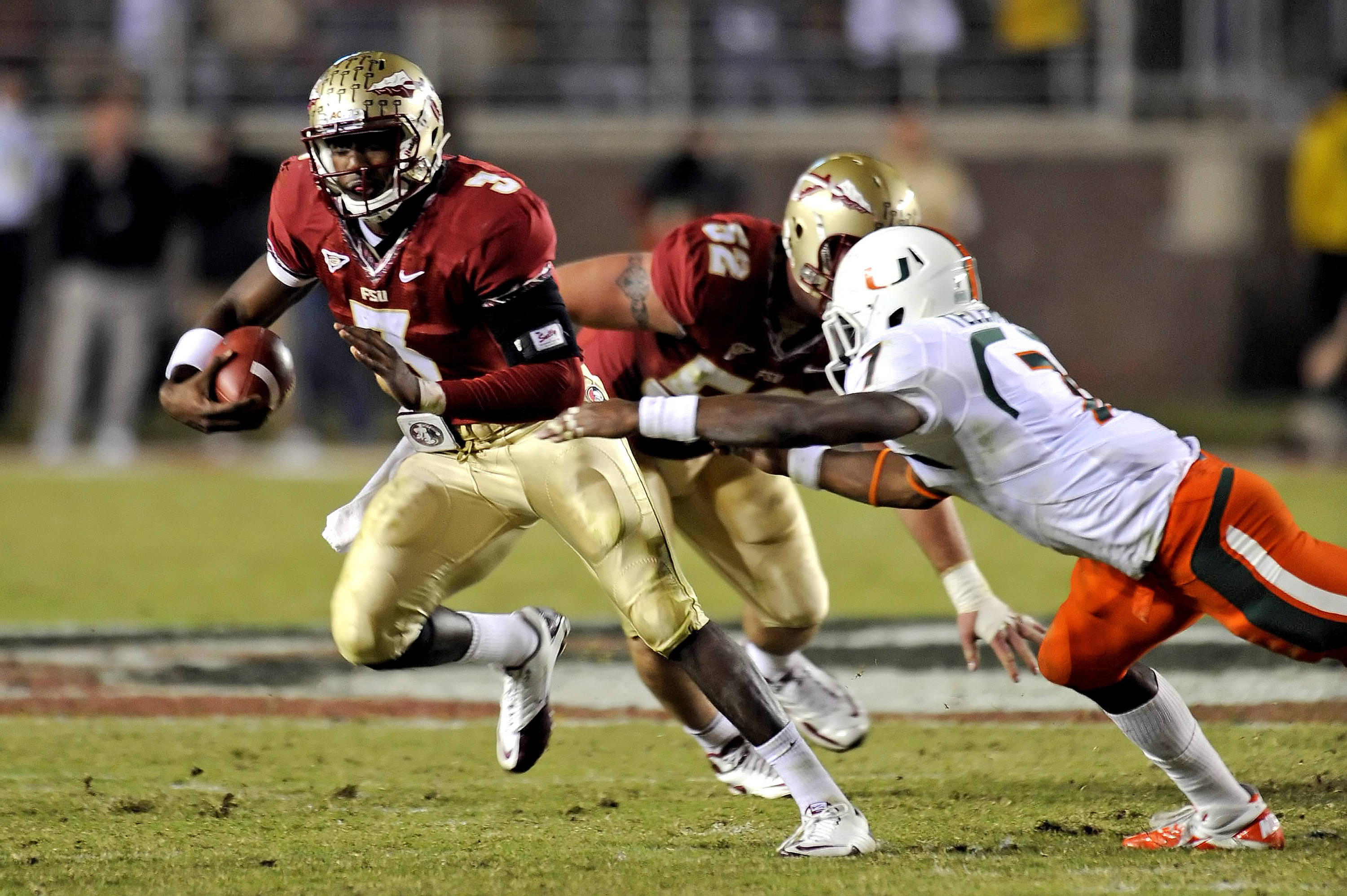 EJ Manuel (3) eludes pressure from a Miami defender on November 12th.  The Seminoles went onto win 23-19 over the Canes.