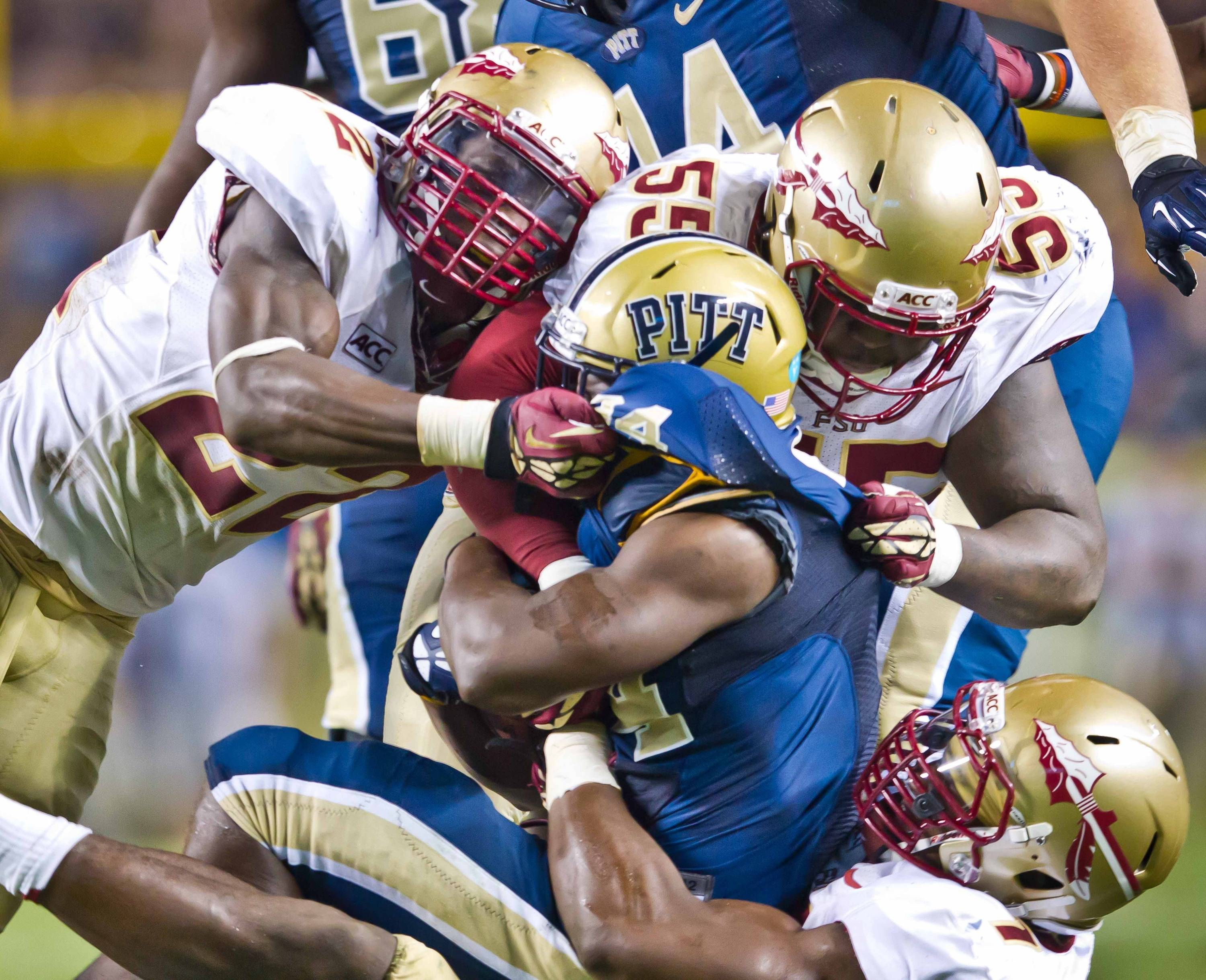 The FSU gang tackles a Panther runner.