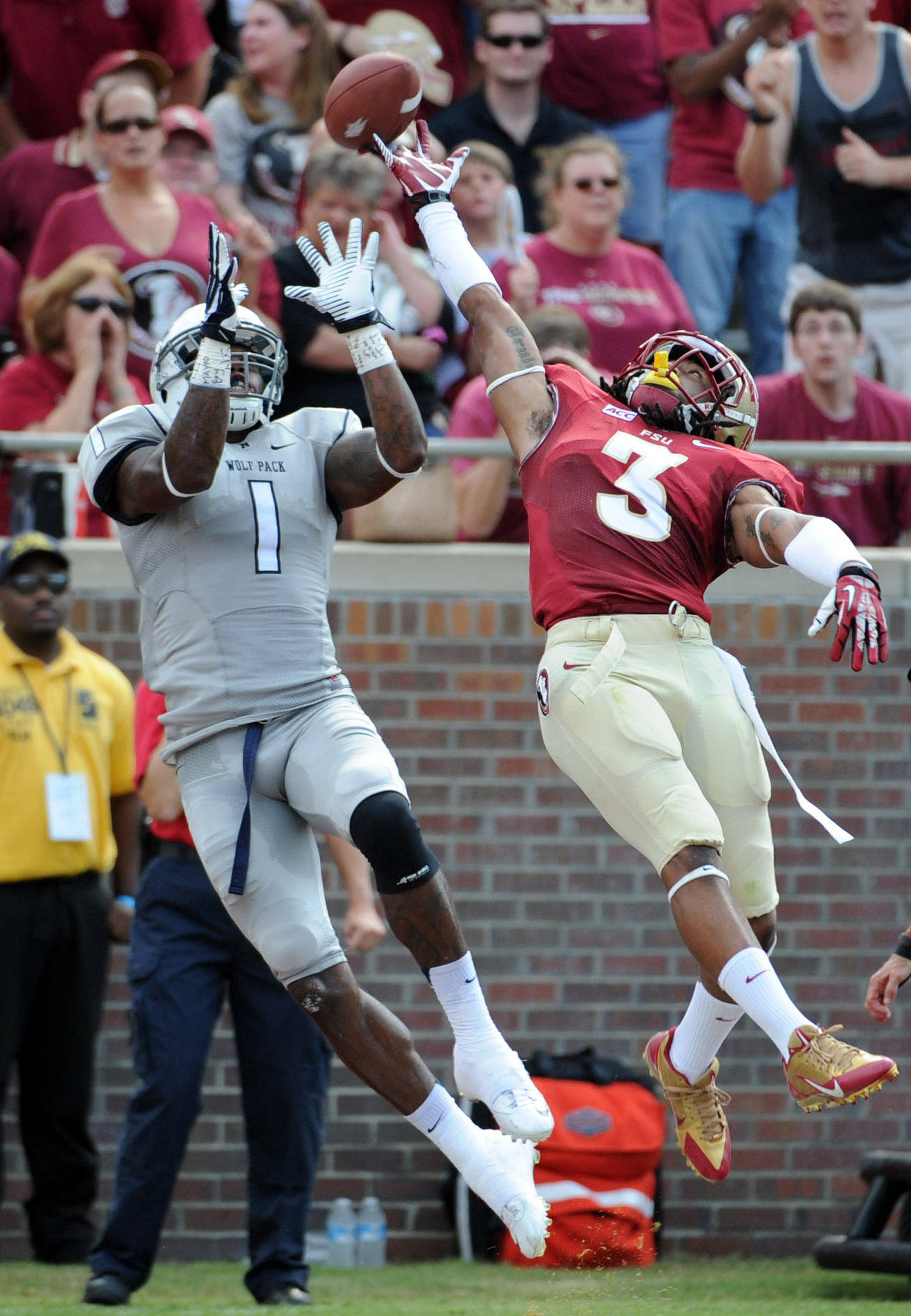 Sep 14, 2013; Tallahassee, FL, USA; Nevada Wolf Pack wide receiver Brandon Wimberly (1) cannot make a catch due to defense from Florida State Seminoles defensive back Ronald Darby (3) during the first half of the game at Doak Campbell Stadium. Mandatory Credit: Melina Vastola-USA TODAY Sports
