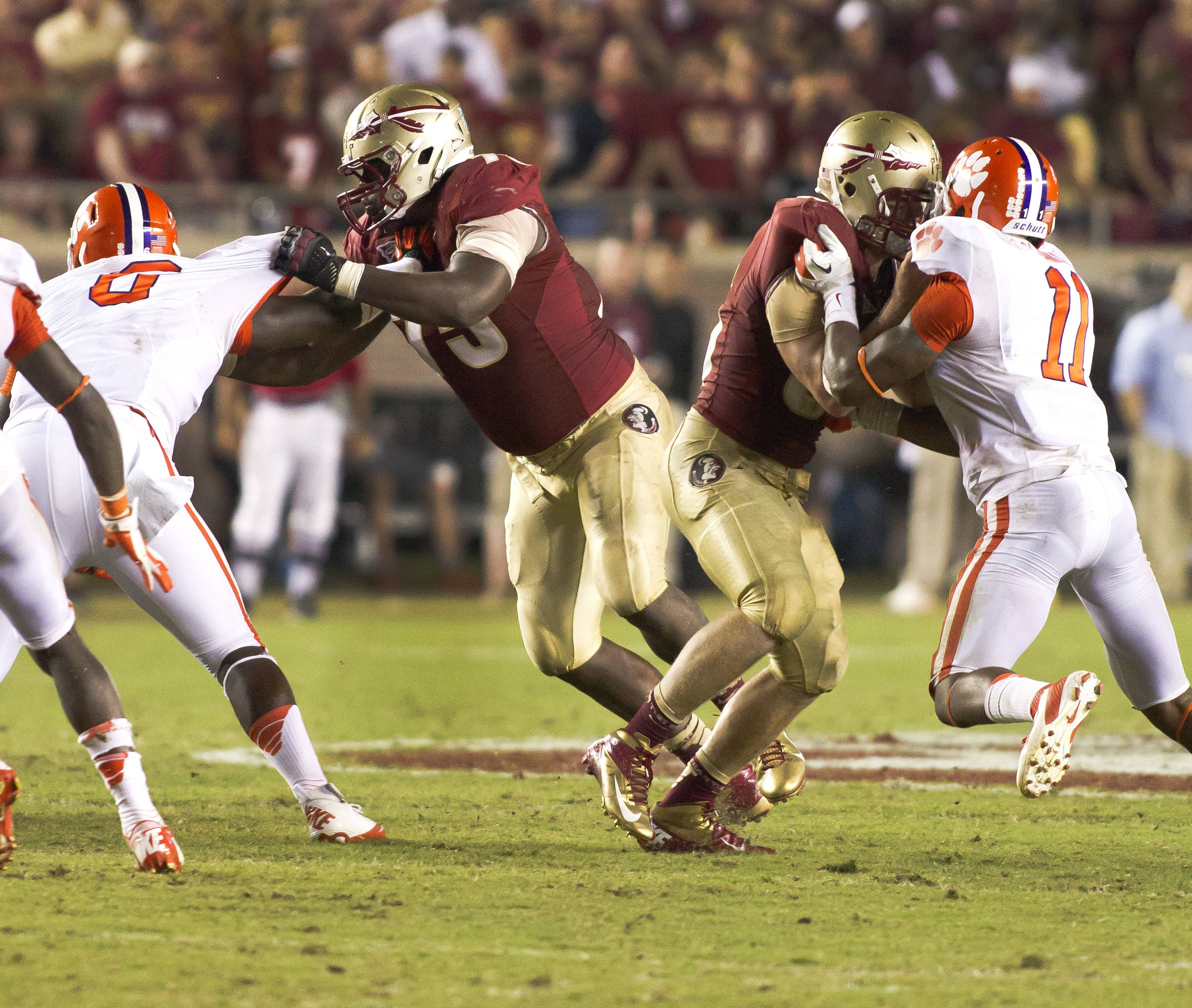 Cameron Erving (7) finishing his block, FSU vs Clemson, 9/22/12 (Photo by Steve Musco)