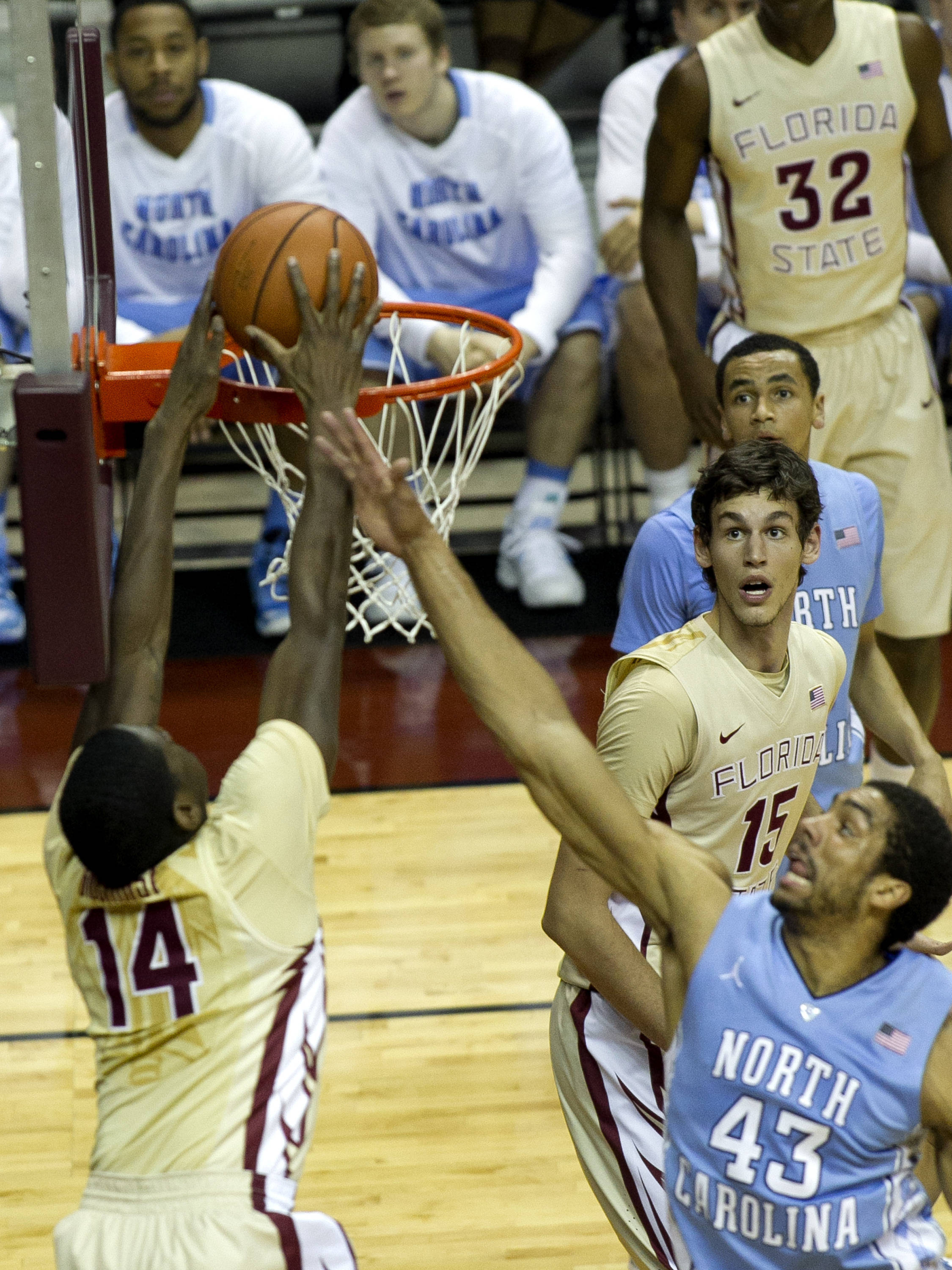 Robert Gilchrist (14) with a jam from a lob pass from Ian Miller(30), FSU vs North Carolina, 2-17-14, (Photo's by Steve Musco)