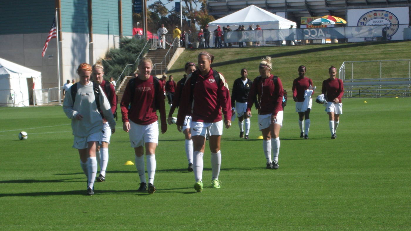 The Seminoles walk to their bench during pregame warm-ups.