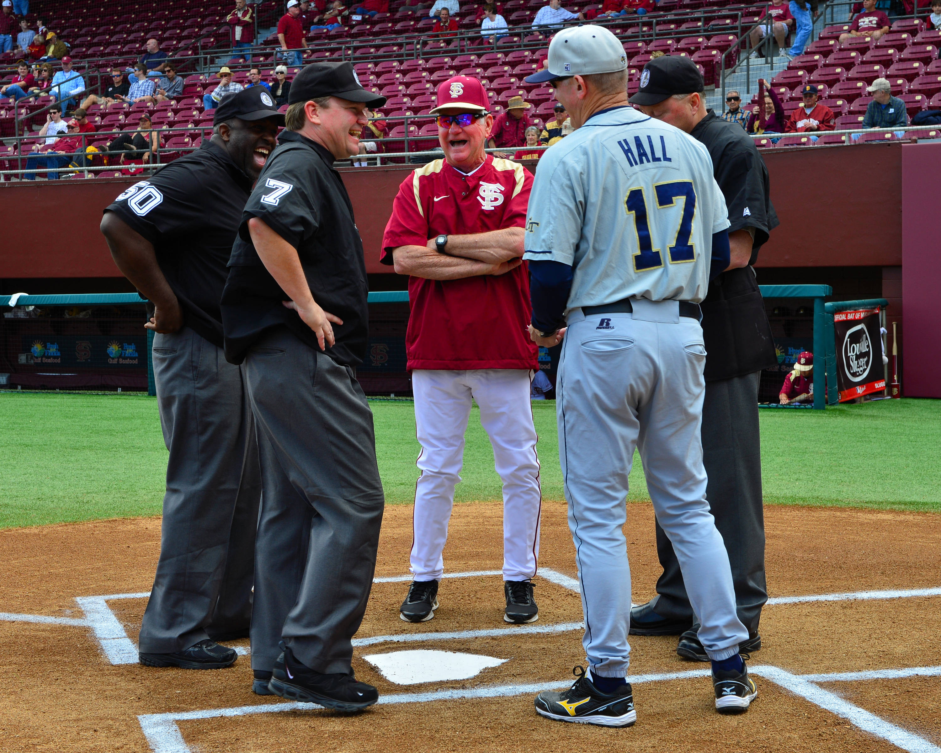 Florida State head coach Mike Martin and Georgia Tech head coach Danny Hall meet with the umpires at home plate before the start of Friday's first game.